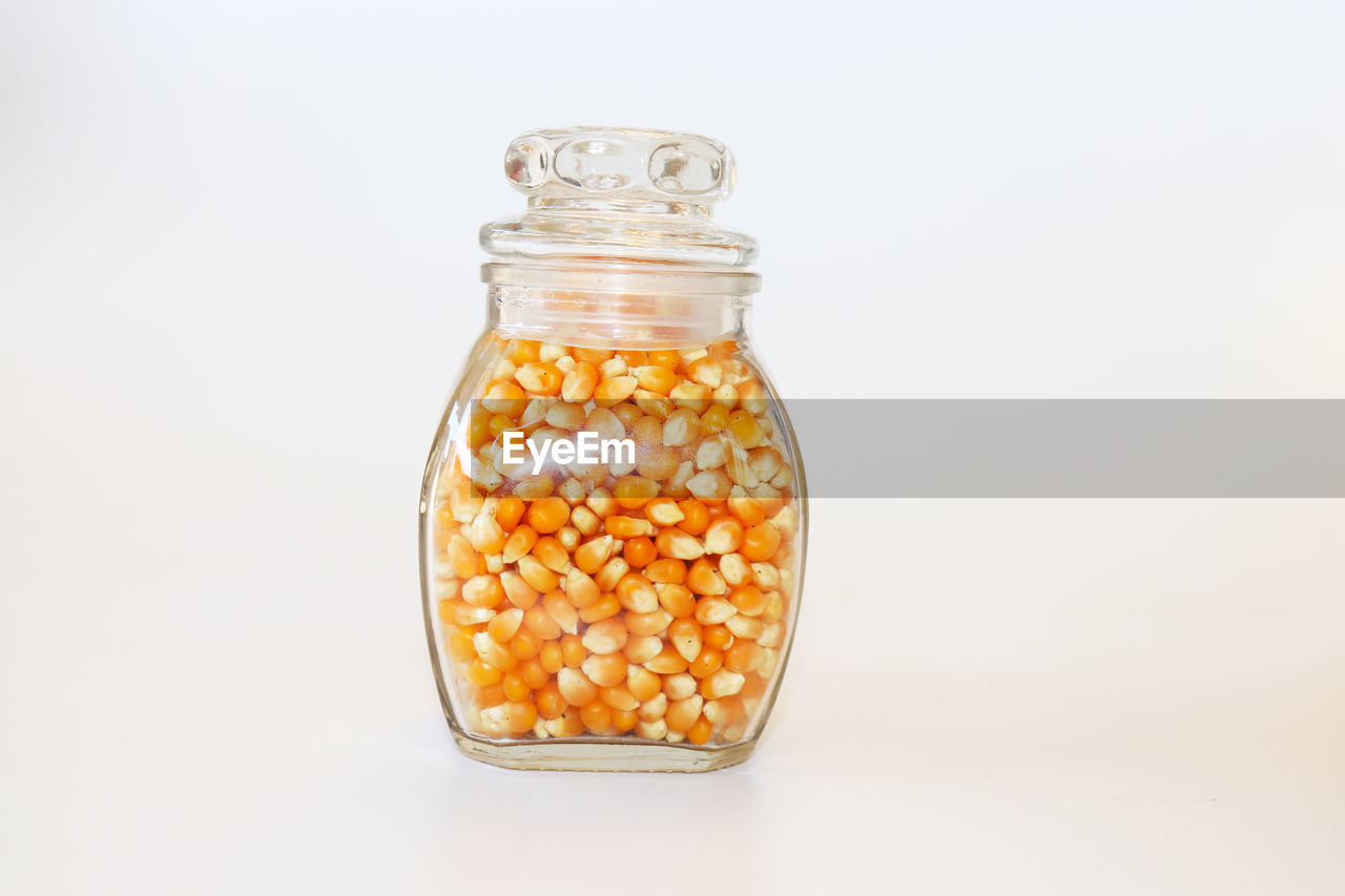 container, studio shot, jar, white background, glass - material, indoors, close-up, food, transparent, still life, food and drink, bottle, cut out, no people, large group of objects, copy space, freshness, wellbeing, healthy eating, abundance, temptation