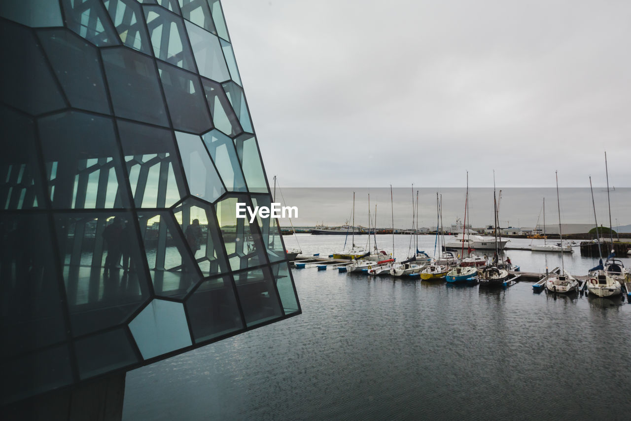 water, nautical vessel, sky, transportation, mode of transportation, architecture, no people, built structure, cloud - sky, nature, building exterior, day, reflection, sea, sailboat, waterfront, outdoors, moored, harbor, luxury, yacht