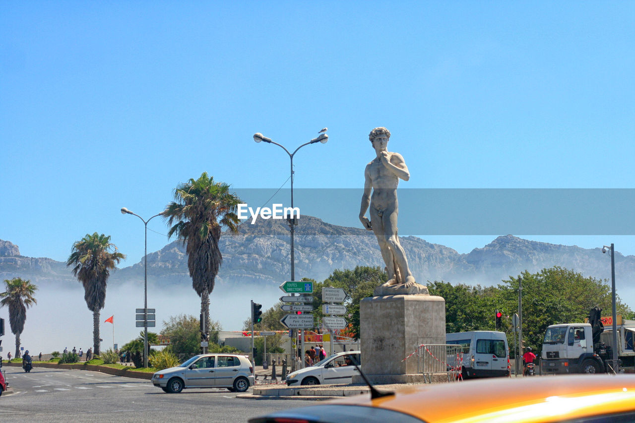 Statue de david by road against clear sky
