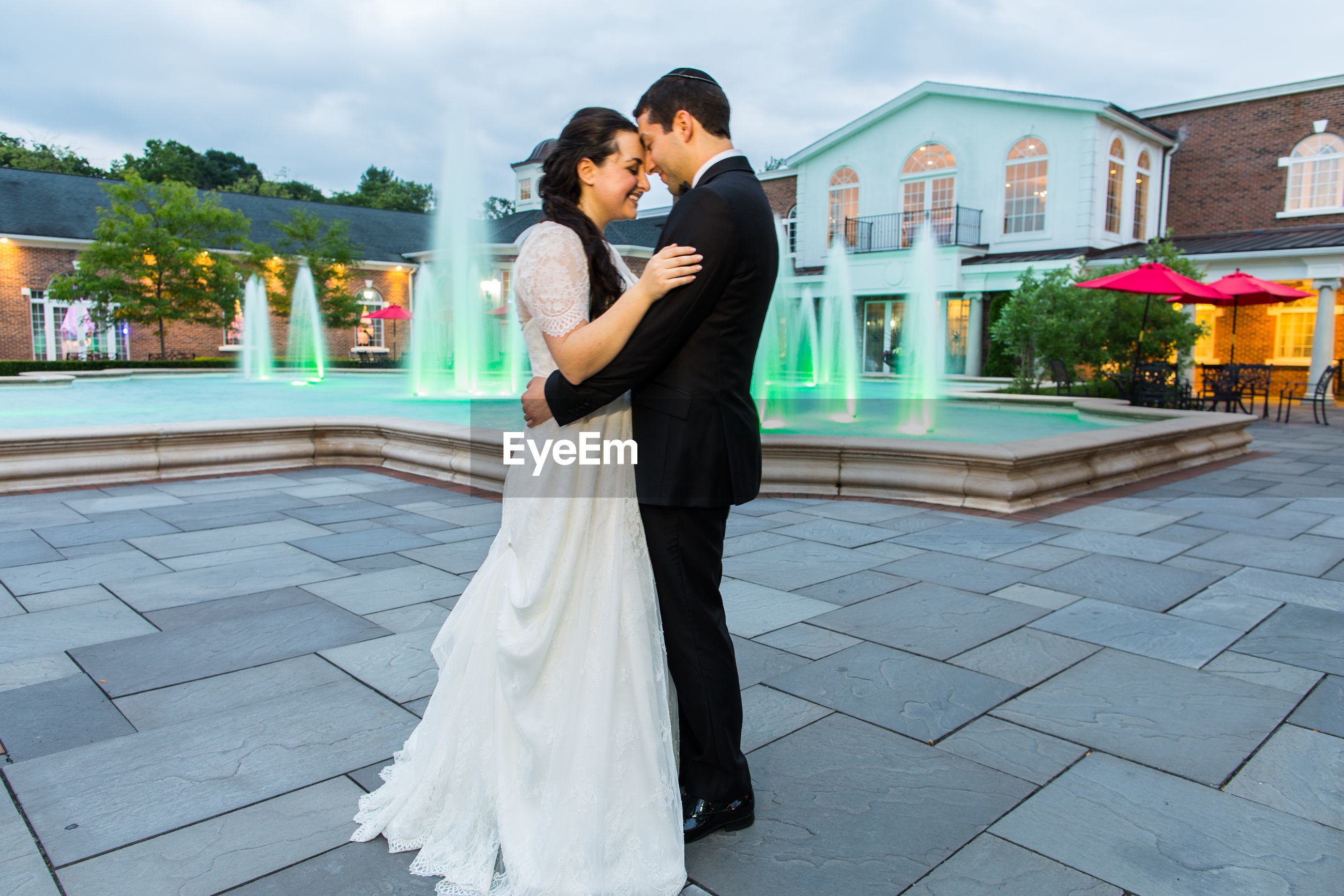 love, two people, romance, togetherness, heterosexual couple, women, embracing, mid adult, young women, young adult, bonding, beautiful people, affectionate, happiness, outdoors, celebration, full length, wedding, adult, people, adults only, wife, smiling, bride, bridegroom, wedding dress, day