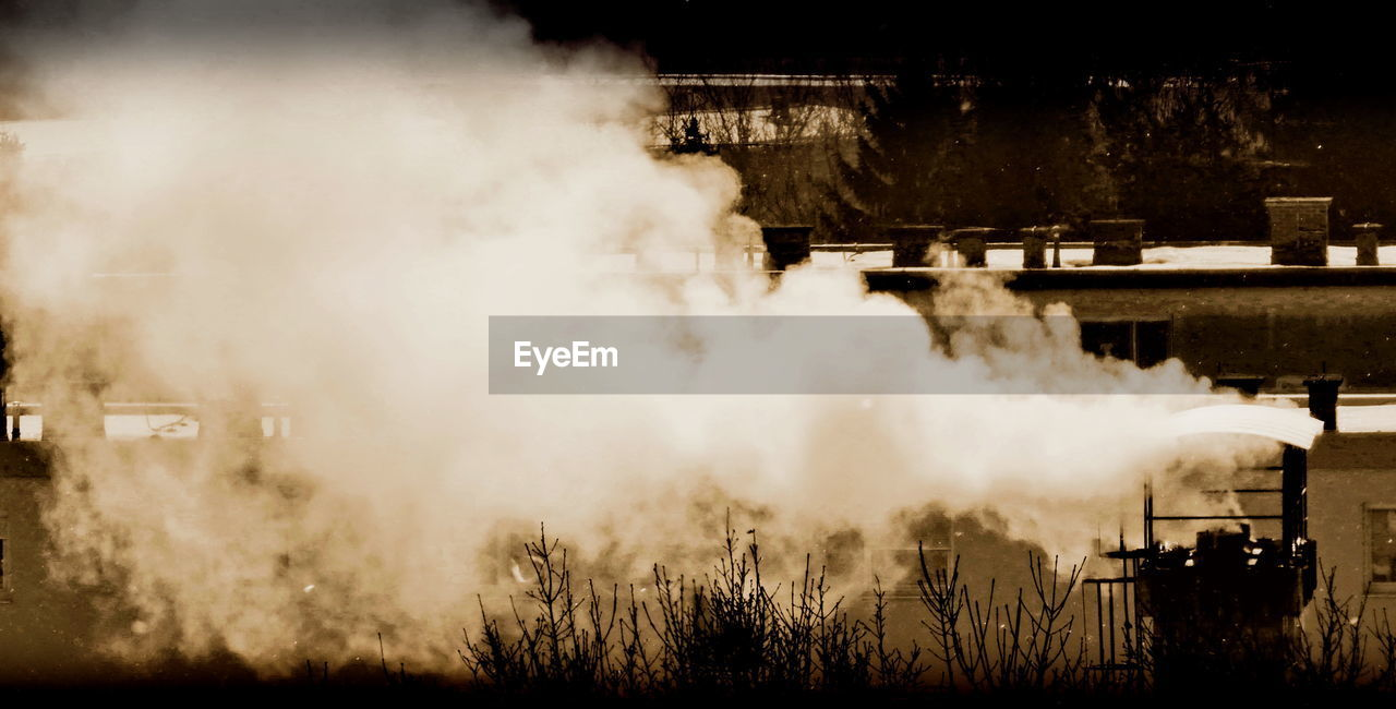 Smoke stack emitting pollution in factory