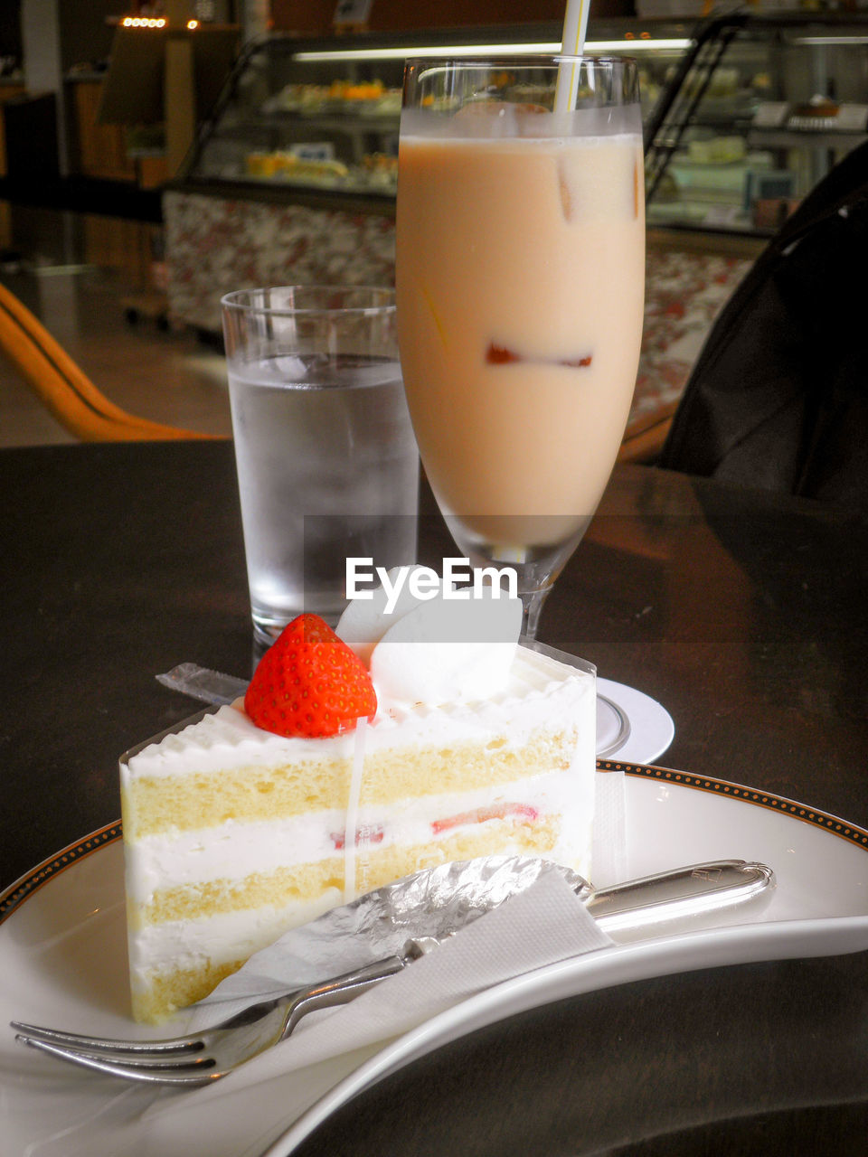 food and drink, dessert, freshness, sweet food, drink, strawberry, food, indulgence, temptation, drinking glass, refreshment, cake, indoors, fruit, no people, close-up, slice, serving size, plate, ready-to-eat, cheesecake, day