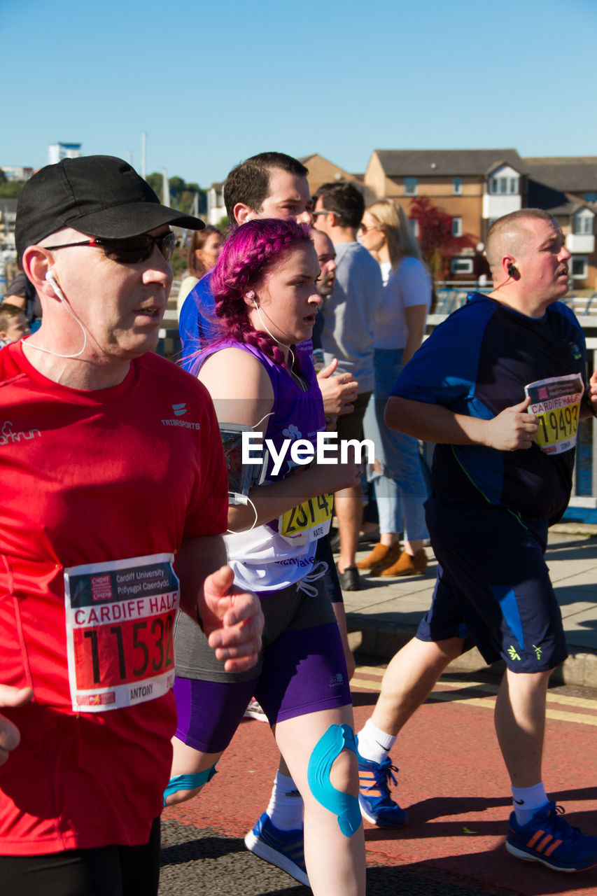 real people, event, outdoors, sunlight, leisure activity, sport, large group of people, day, competition, sportsman