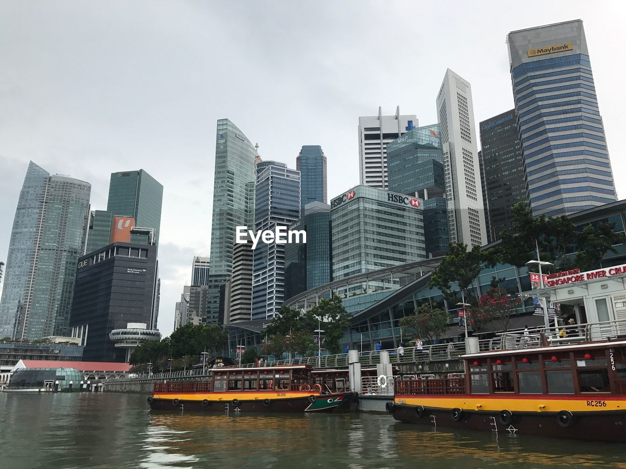 building exterior, architecture, built structure, city, building, water, transportation, nautical vessel, office building exterior, sky, mode of transportation, tall - high, waterfront, river, skyscraper, office, urban skyline, modern, no people, cityscape, outdoors, financial district, passenger craft