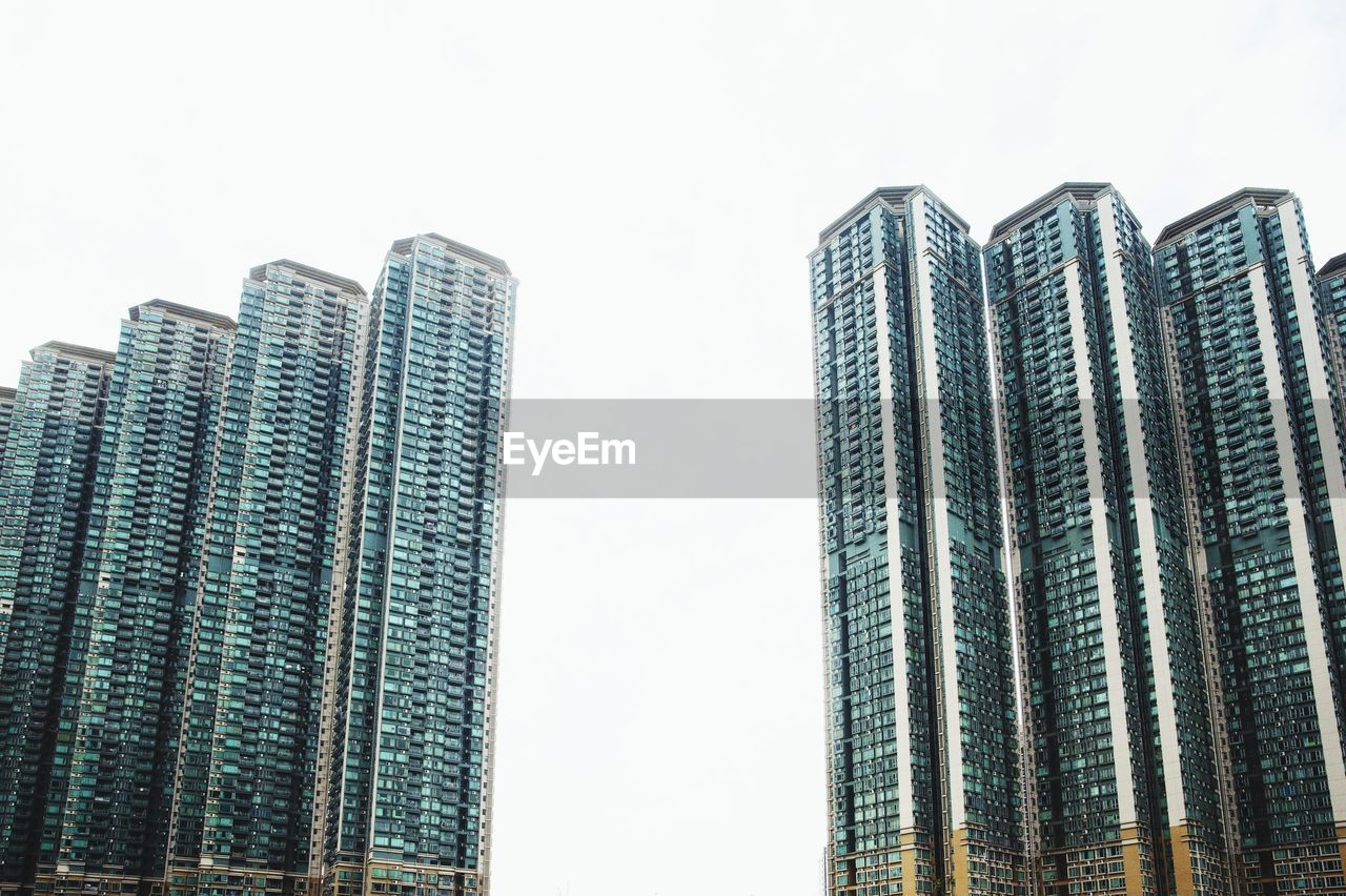 building exterior, architecture, sky, built structure, tall - high, low angle view, building, clear sky, no people, office building exterior, nature, city, skyscraper, day, modern, office, tower, outdoors, development, pattern, financial district