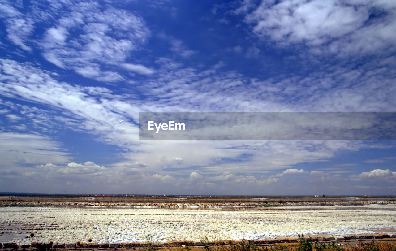 cloud - sky, sky, environment, tranquil scene, scenics - nature, tranquility, landscape, beauty in nature, nature, land, day, no people, horizon, blue, non-urban scene, field, outdoors, horizon over land, idyllic, agriculture