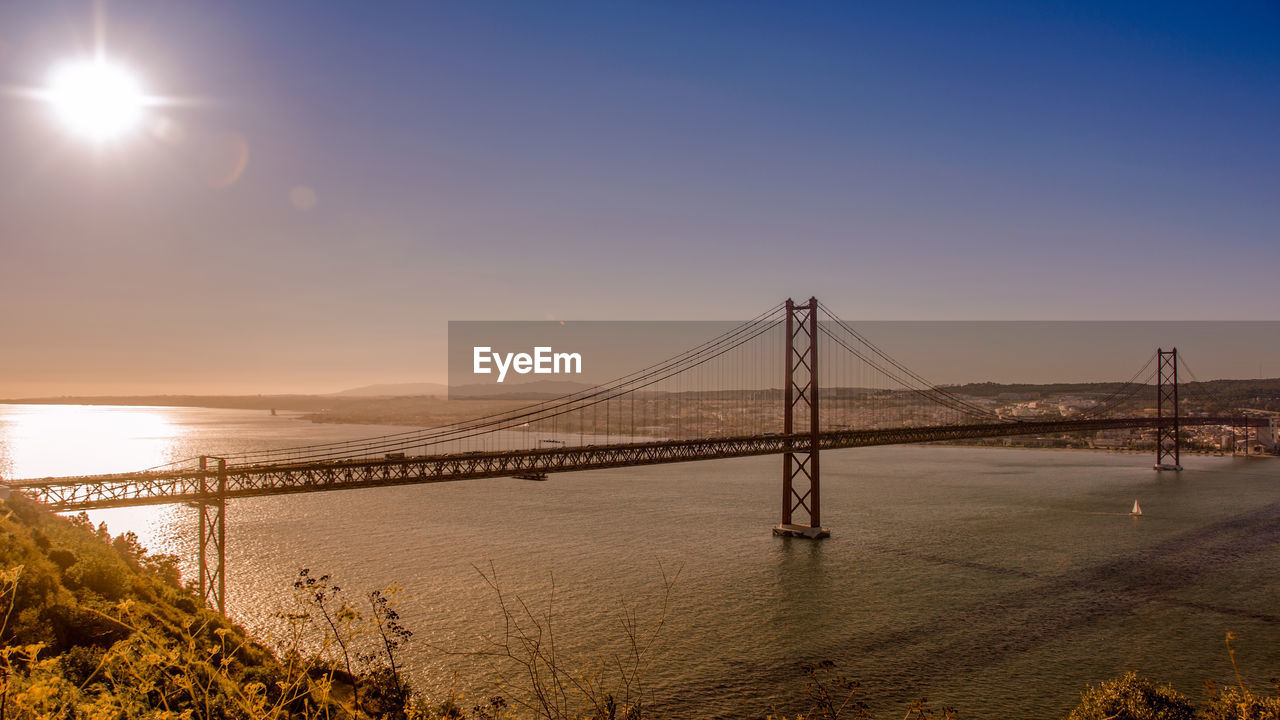 water, sky, bridge, connection, bridge - man made structure, engineering, suspension bridge, built structure, architecture, nature, transportation, beauty in nature, sea, scenics - nature, sunset, tranquil scene, tranquility, sun, bay, outdoors