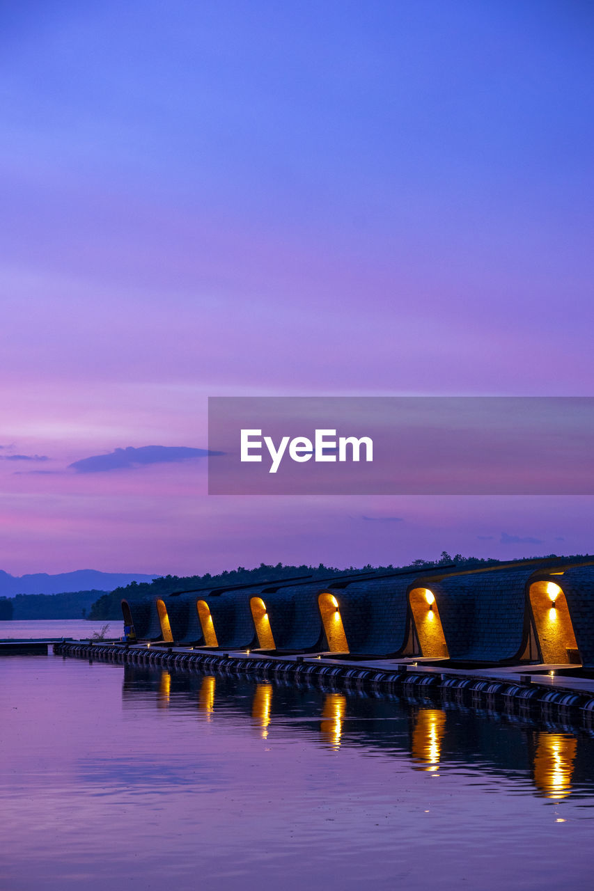 sky, water, illuminated, sunset, cloud - sky, scenics - nature, nature, no people, beauty in nature, tranquil scene, sea, waterfront, tranquility, reflection, architecture, dusk, connection, orange color, bridge, bridge - man made structure, outdoors, light, purple