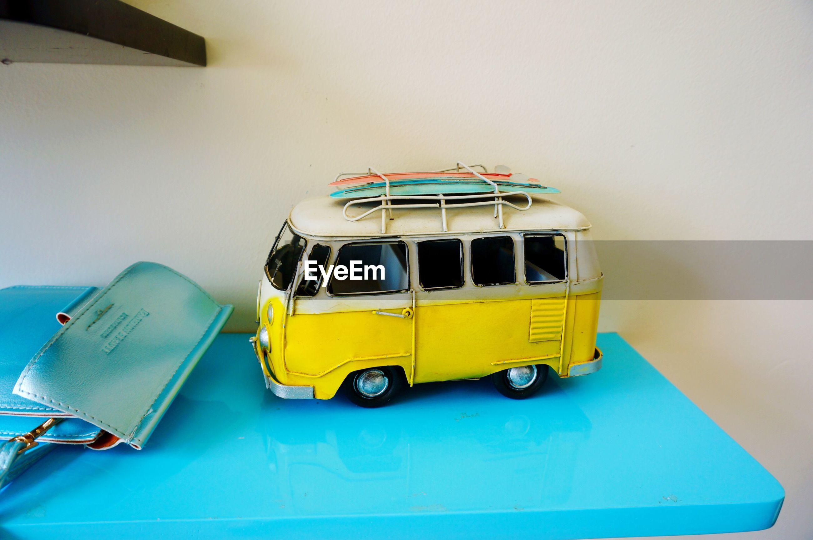 yellow, indoors, transportation, mode of transport, blue, land vehicle, multi colored, close-up, day, no people, toy, car, technology, wall - building feature, copy space, green color, stationary, modern, childhood, travel
