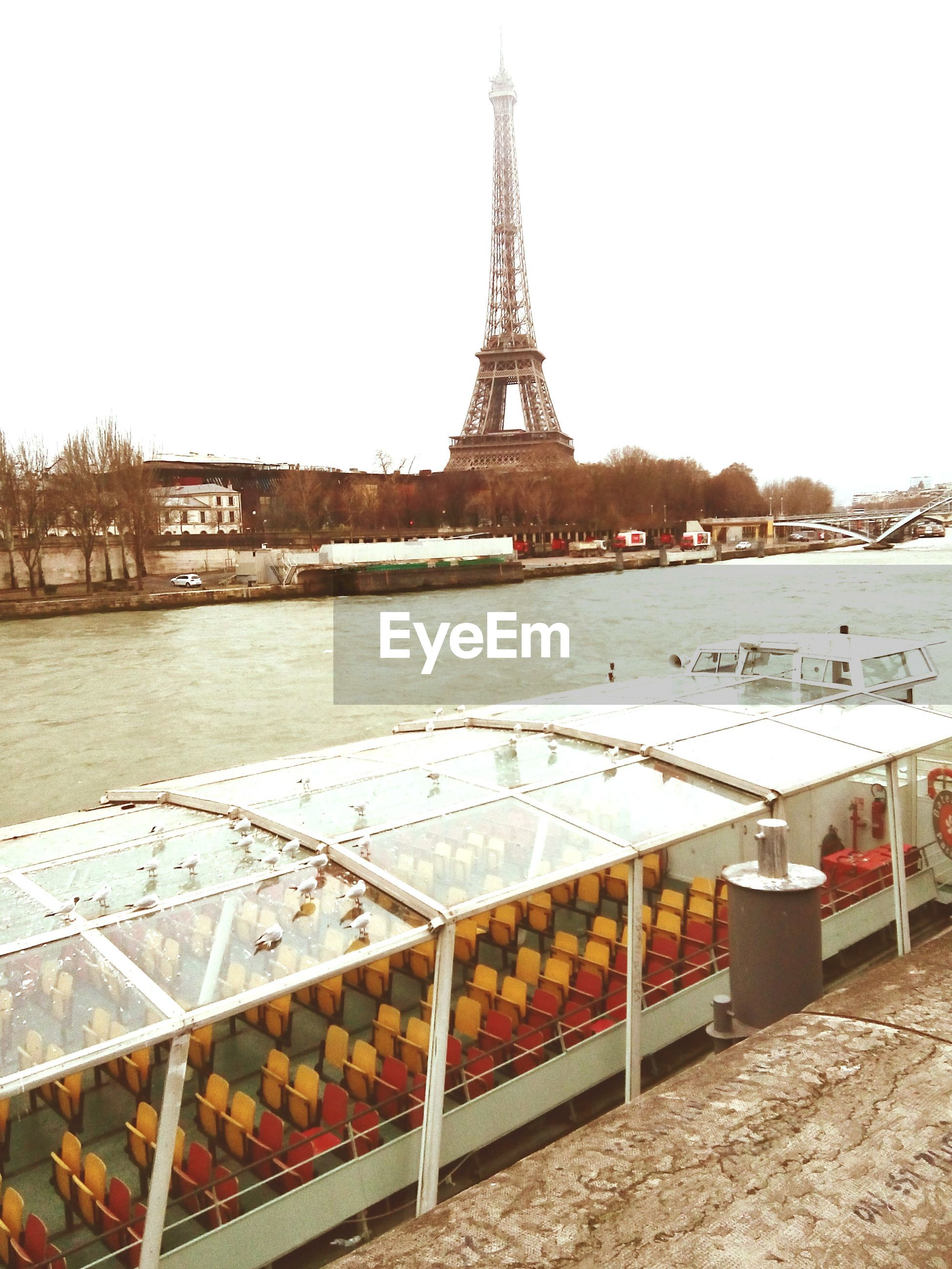 built structure, architecture, clear sky, building exterior, famous place, travel destinations, water, international landmark, tourism, eiffel tower, travel, capital cities, river, culture, metal, bridge - man made structure, city, outdoors, day, history