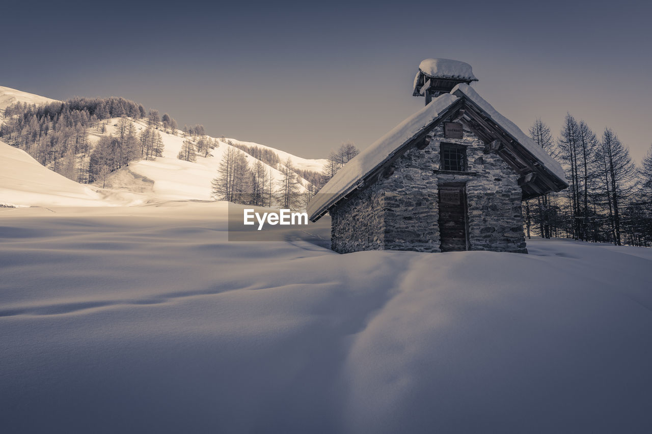 BUILDING AGAINST SKY DURING WINTER