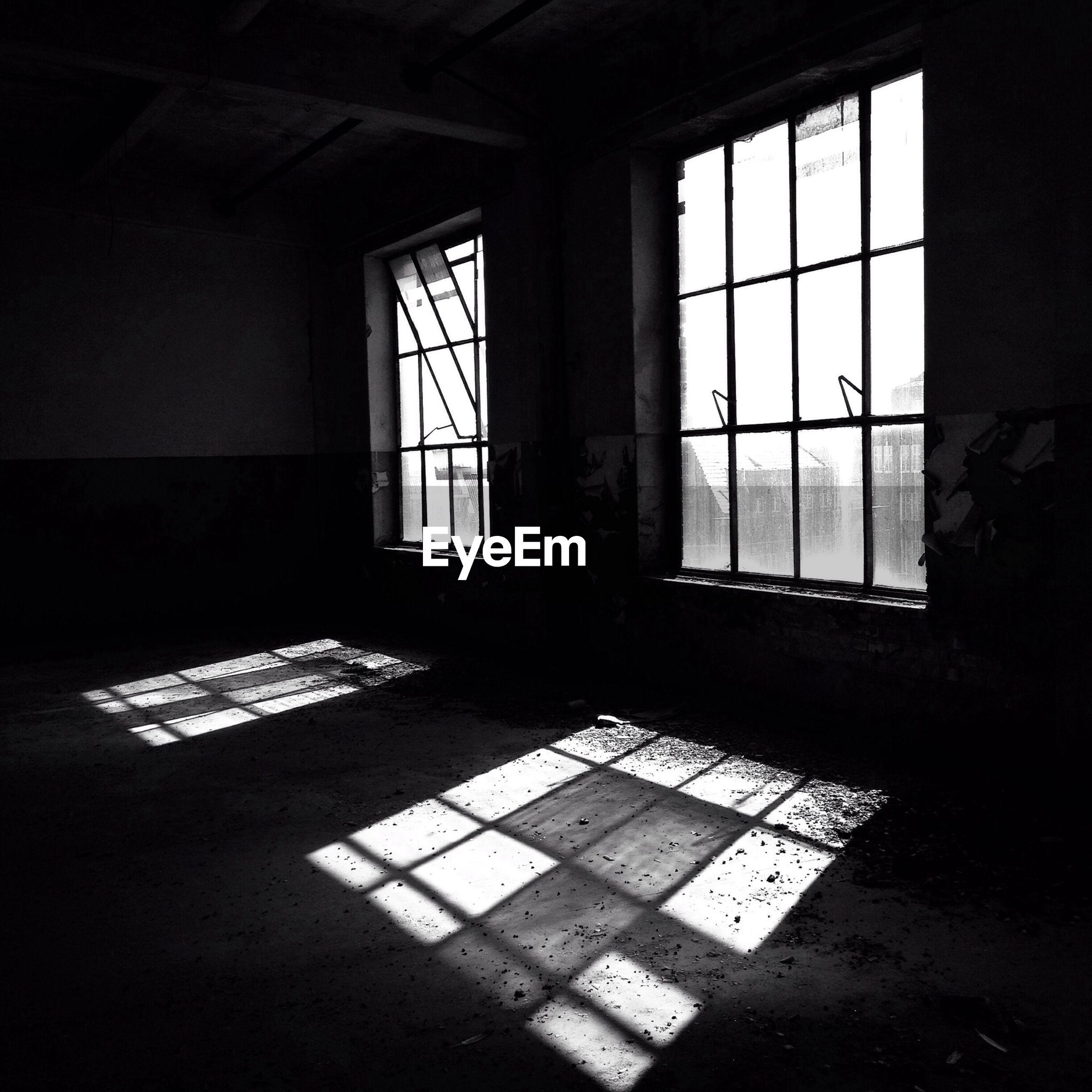 Sunlight emitting through window in abandoned home