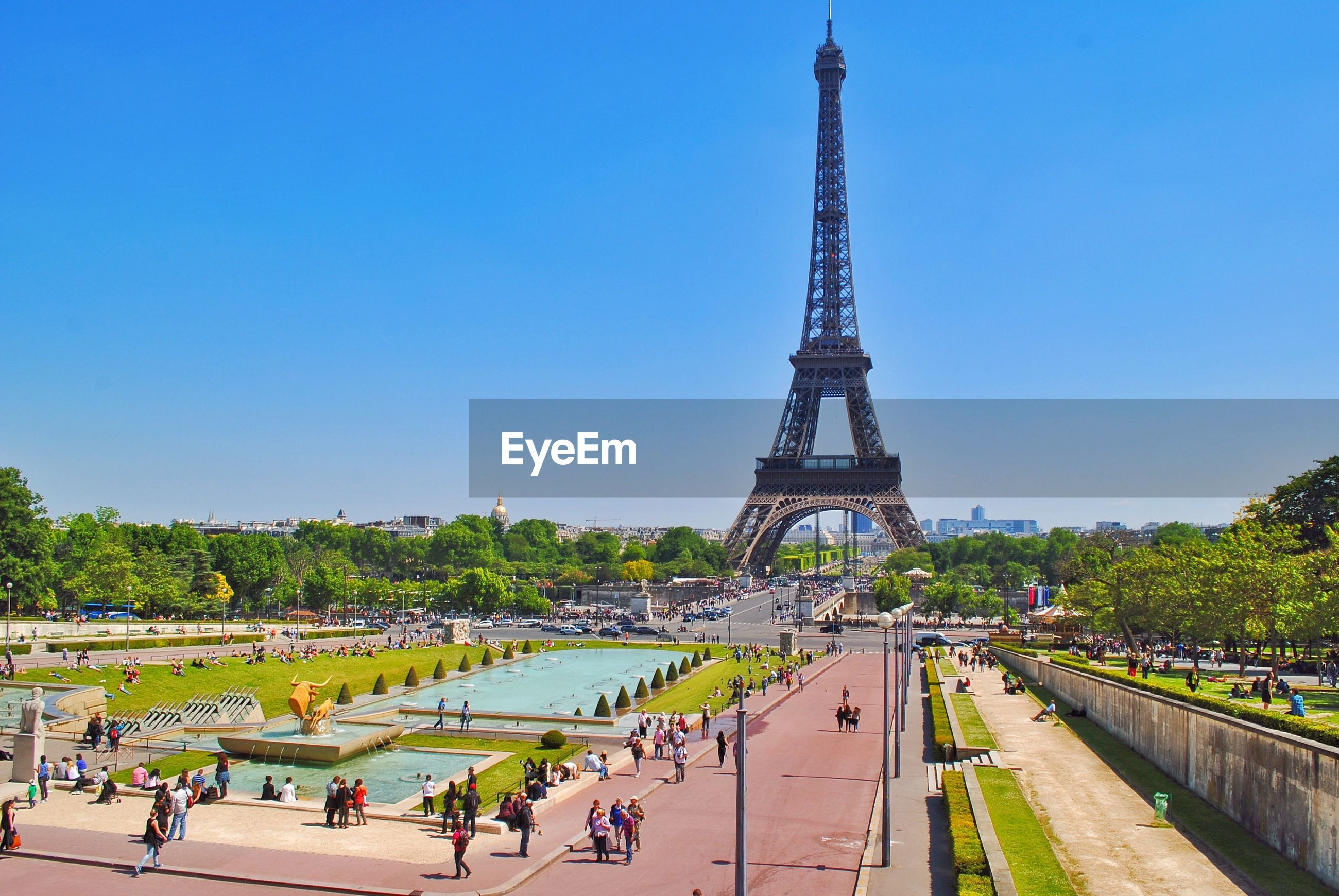 High angle view of tourists by eiffel tower against blue sky