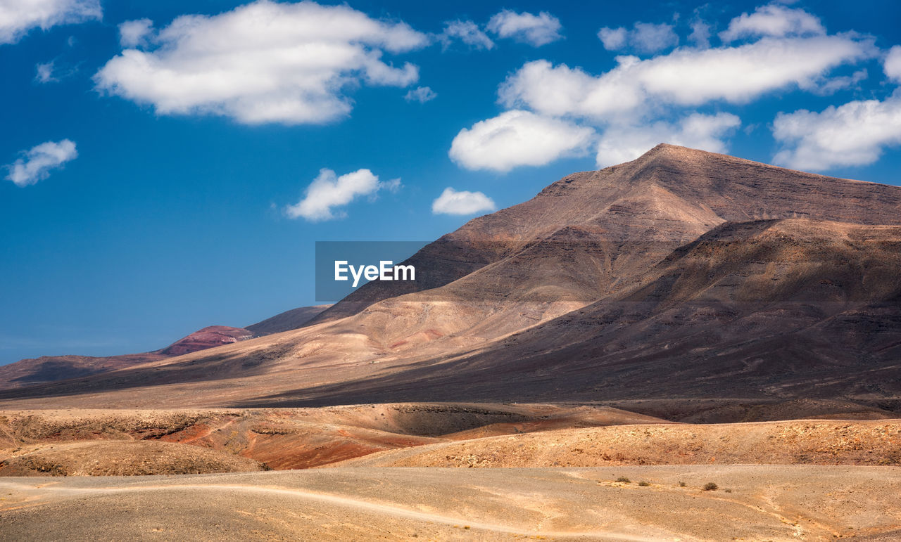 scenics - nature, sky, landscape, cloud - sky, beauty in nature, tranquil scene, environment, tranquility, desert, mountain, non-urban scene, land, nature, day, no people, physical geography, climate, arid climate, geology, remote, outdoors, formation