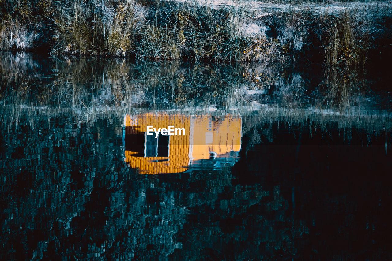 Reflection Of House On Lake