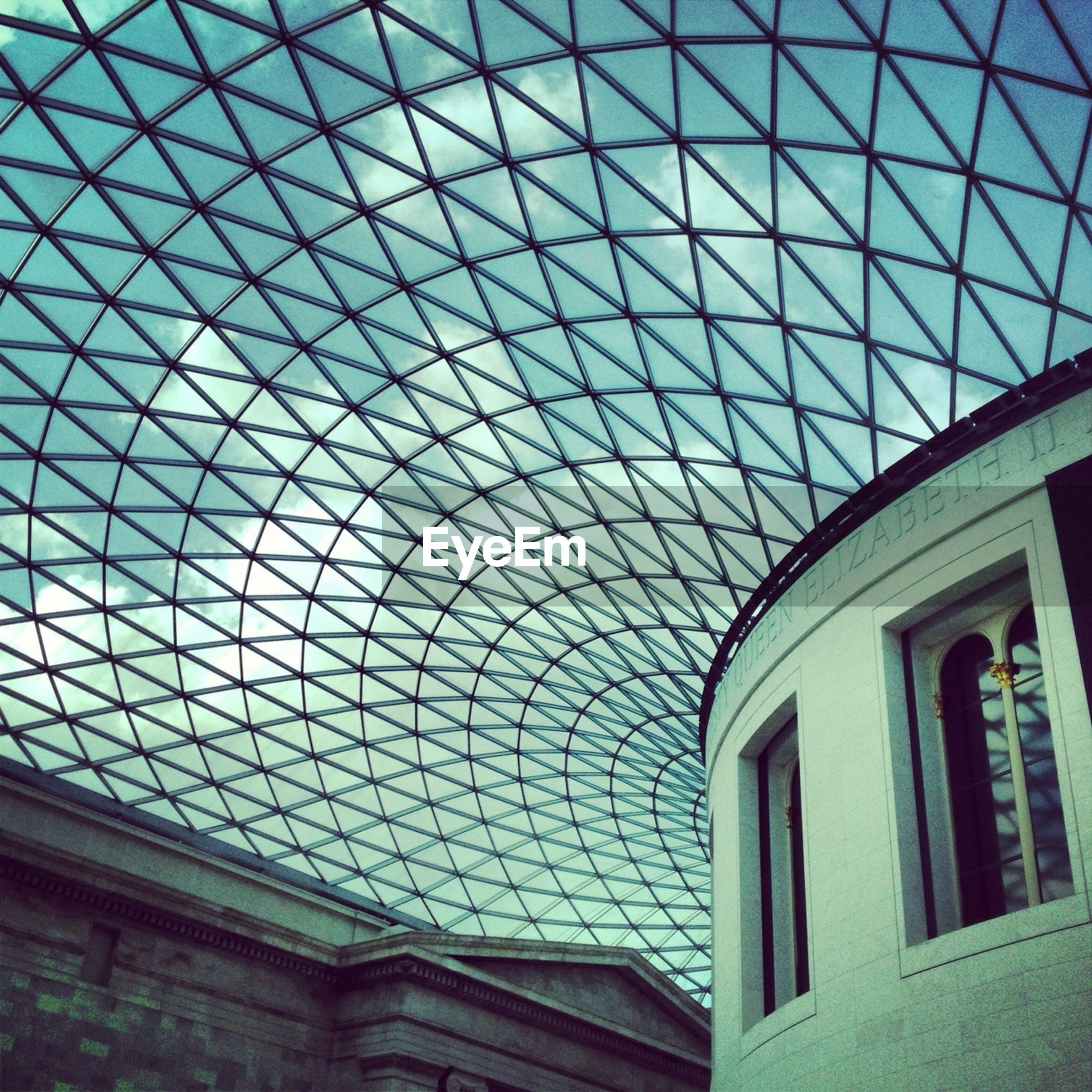 architecture, ceiling, built structure, indoors, low angle view, architectural feature, skylight, pattern, glass - material, design, dome, window, modern, interior, directly below, building exterior, famous place, no people, day, arch