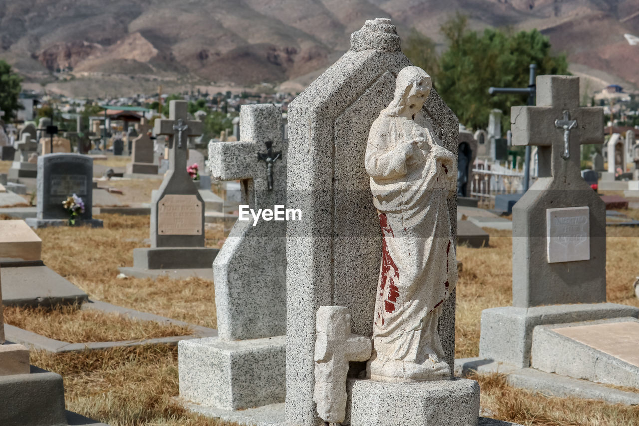architecture, grave, tombstone, cemetery, religion, stone, history, the past, belief, memorial, spirituality, day, sadness, built structure, art and craft, representation, stone material, no people, outdoors