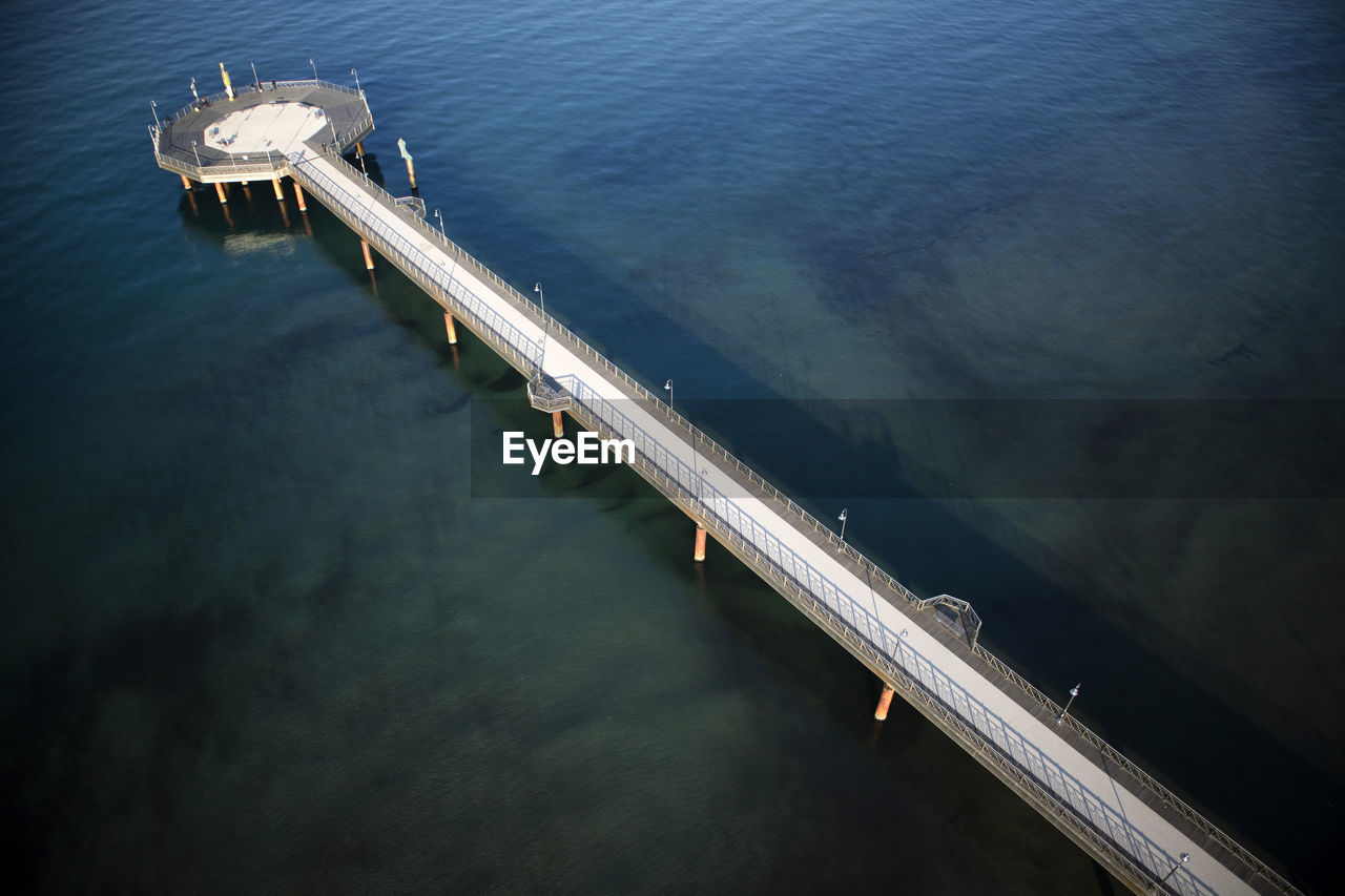 water, sea, transportation, high angle view, no people, nature, nautical vessel, motion, architecture, day, mode of transportation, pier, industry, outdoors, fuel and power generation, connection, scenics - nature, built structure, speed