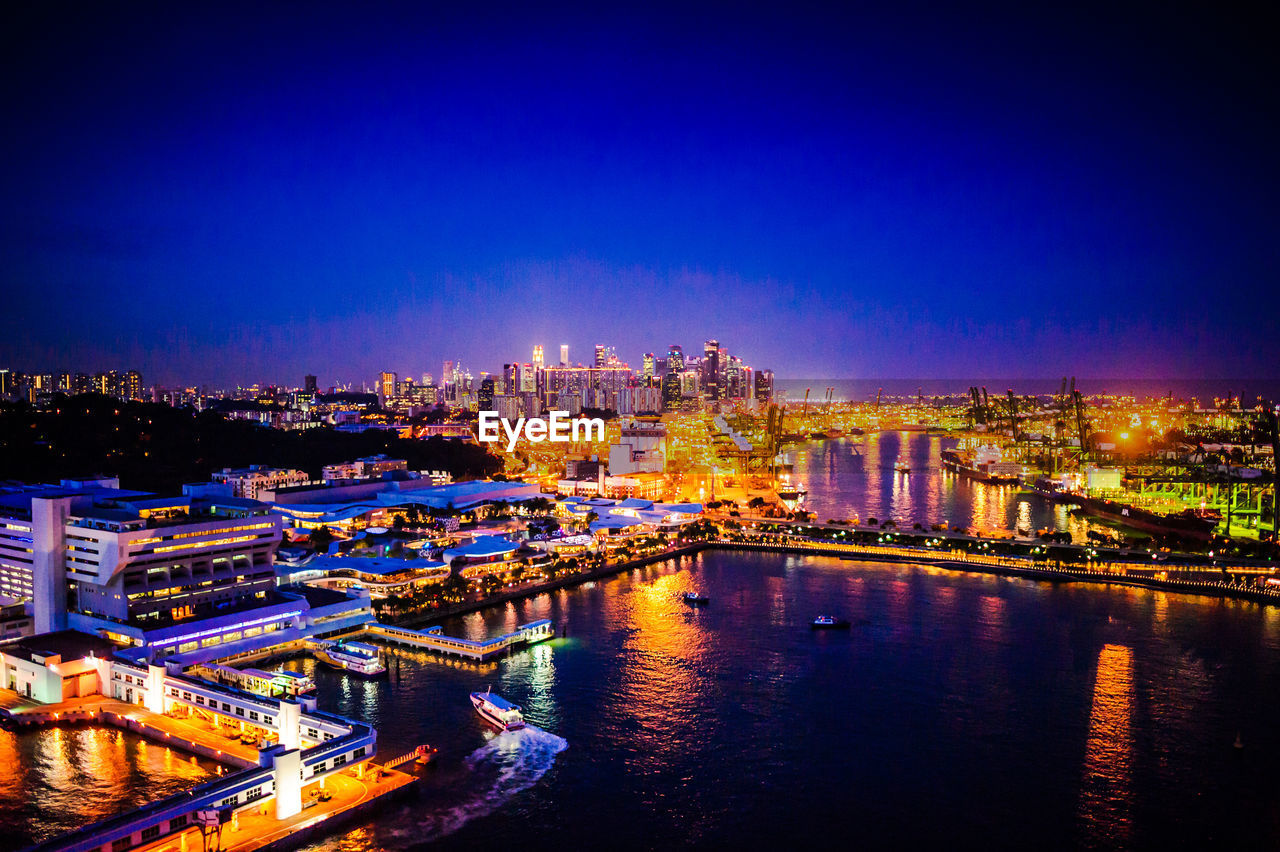 architecture, building exterior, city, illuminated, built structure, night, water, cityscape, sky, building, river, no people, blue, nature, transportation, city life, waterfront, residential district, dusk, outdoors, skyscraper, office building exterior