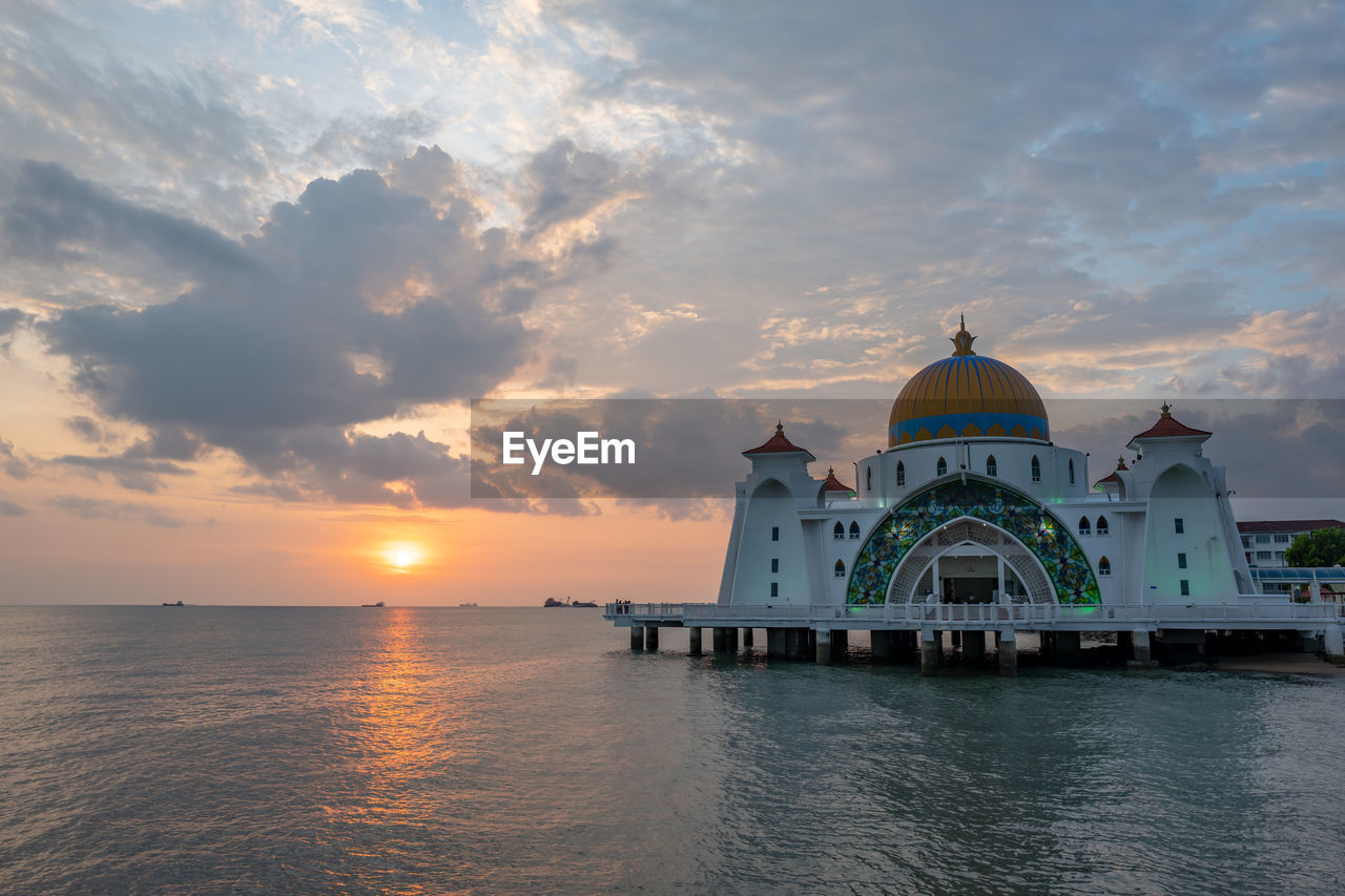 sky, sunset, cloud - sky, water, dome, built structure, religion, spirituality, architecture, place of worship, building exterior, belief, waterfront, building, travel destinations, no people, nature, outdoors