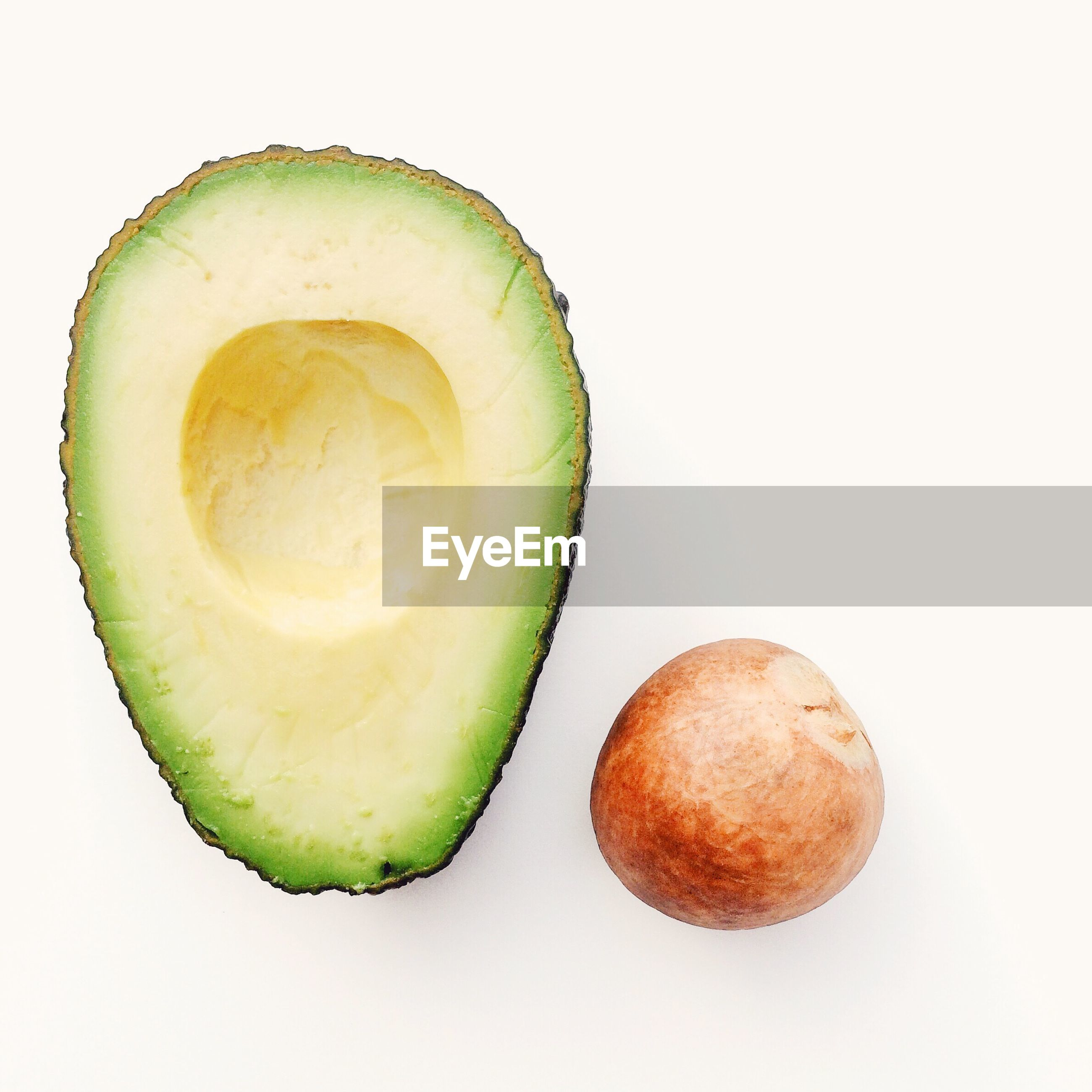 Close-up of avocado slice against white background
