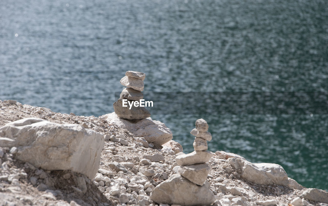 water, rock, solid, rock - object, no people, sea, nature, day, focus on foreground, zen-like, land, tranquility, outdoors, close-up, balance, beauty in nature, rock formation, beach, scenics - nature, at the edge of