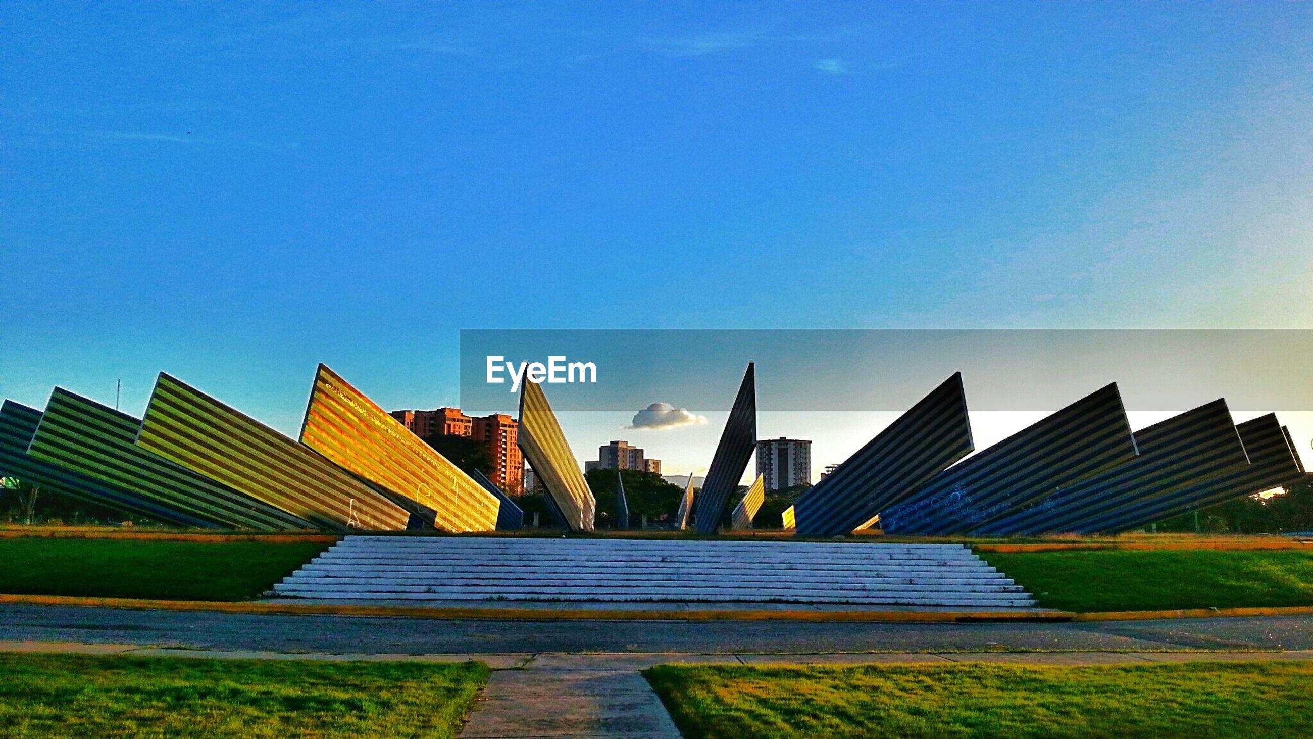Monumento al sol naciente against blue sky