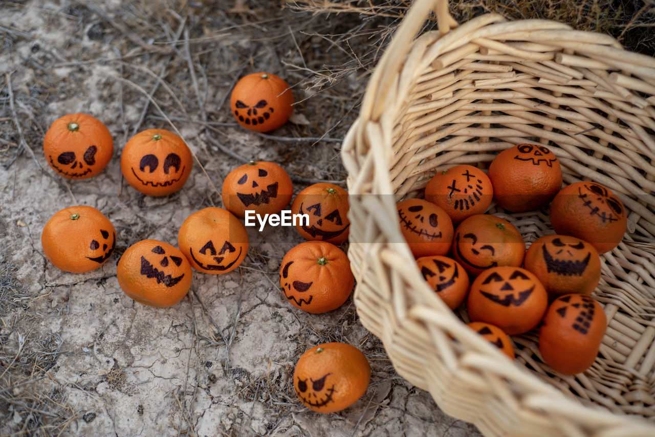 basket, container, food and drink, halloween, pumpkin, no people, food, orange color, celebration, wicker, craft, large group of objects, creativity, freshness, art and craft, close-up, healthy eating, still life, jack o' lantern