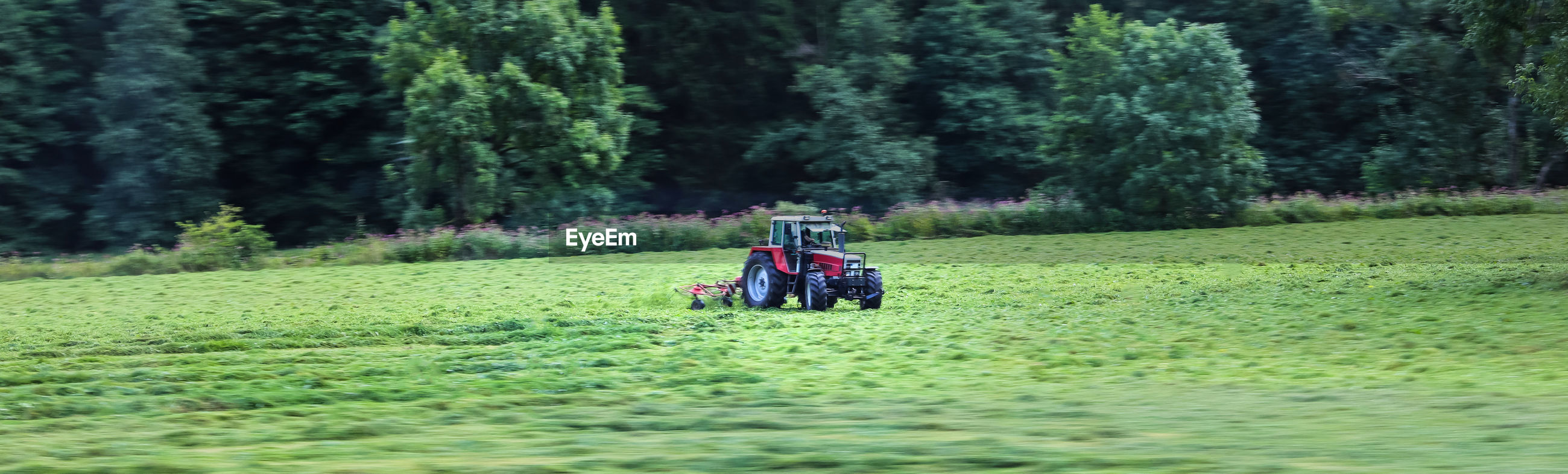 Panoramic shot of tractor on field