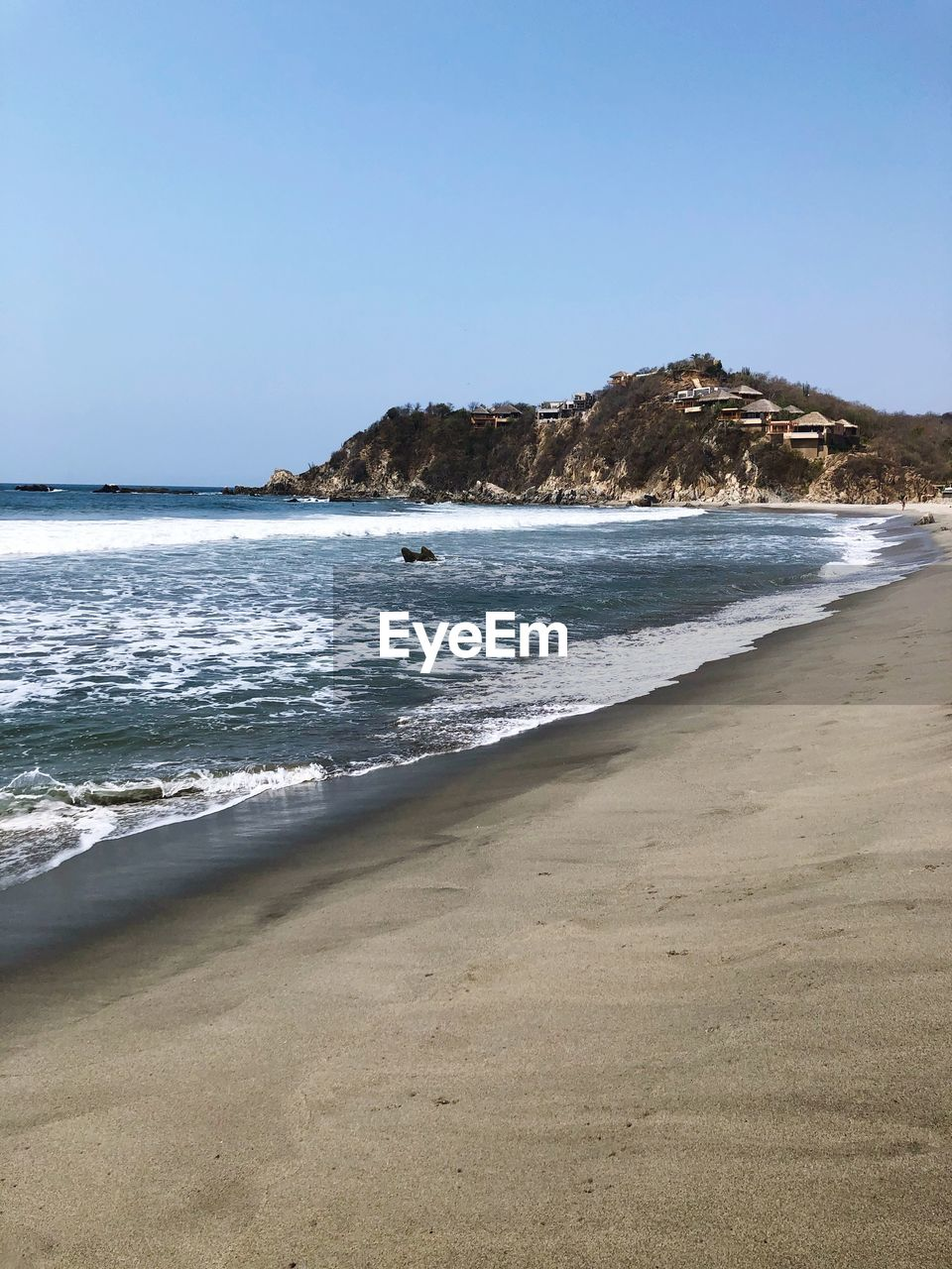 sea, water, land, beach, sky, scenics - nature, beauty in nature, clear sky, wave, nature, motion, sand, copy space, tranquility, tranquil scene, day, horizon, sport, horizon over water, no people, outdoors