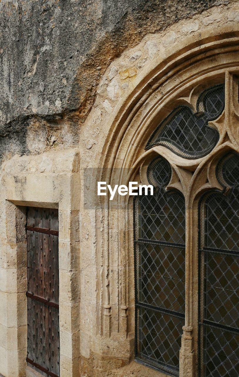 Window Of Historic Monolithic Church At Aquitaine