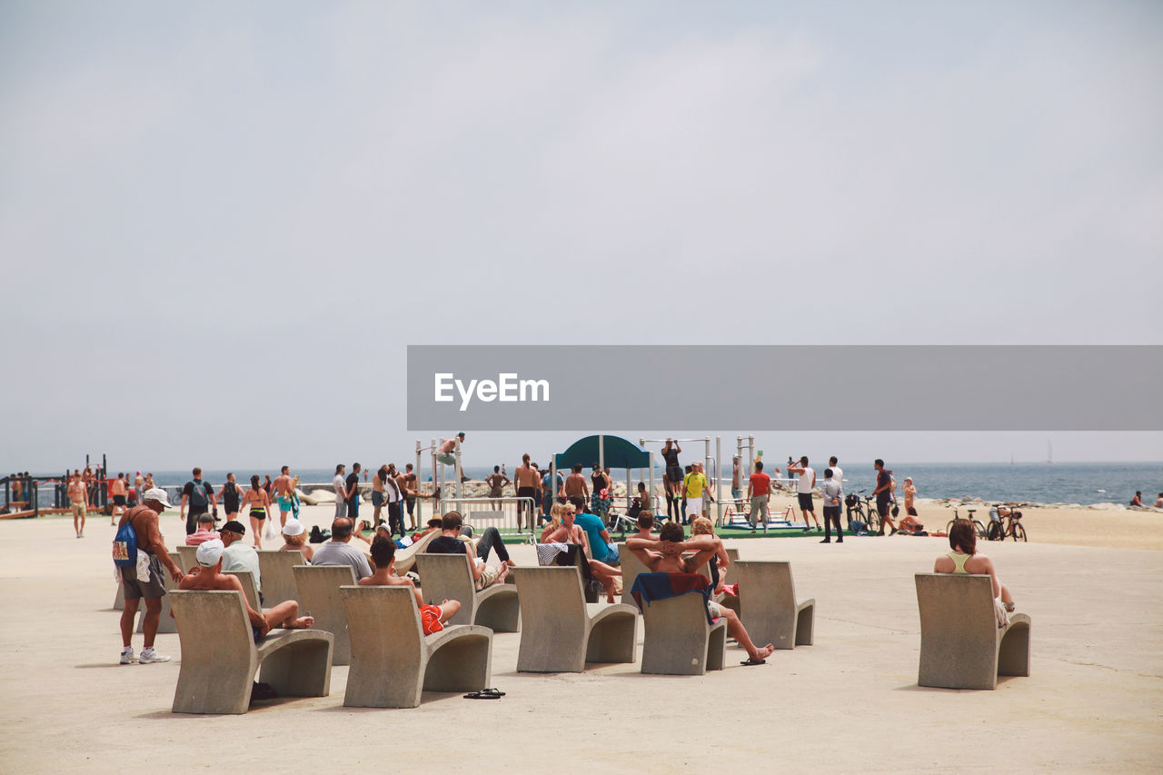 beach, large group of people, sea, sand, men, real people, outdoors, nature, leisure activity, day, women, chair, sky, vacations, horizon over water, water, people