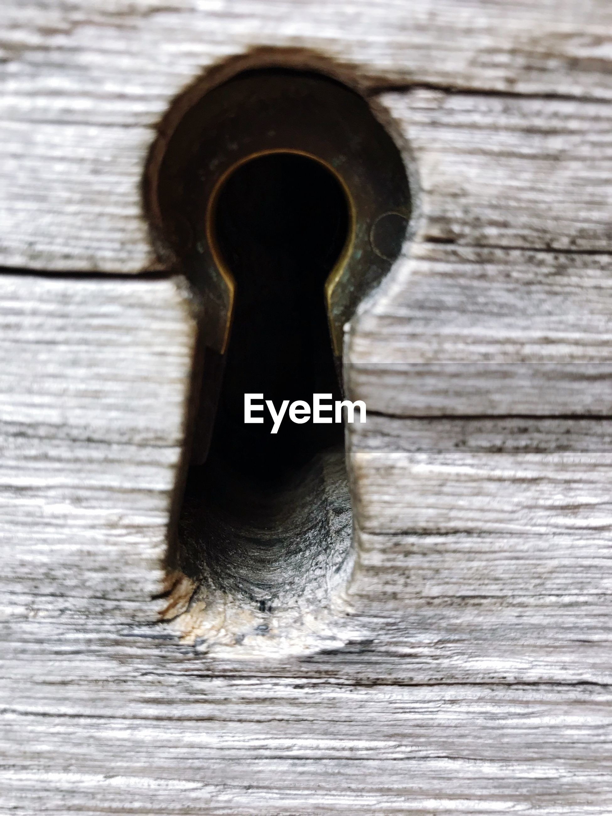Close-up of keyhole on wooden door