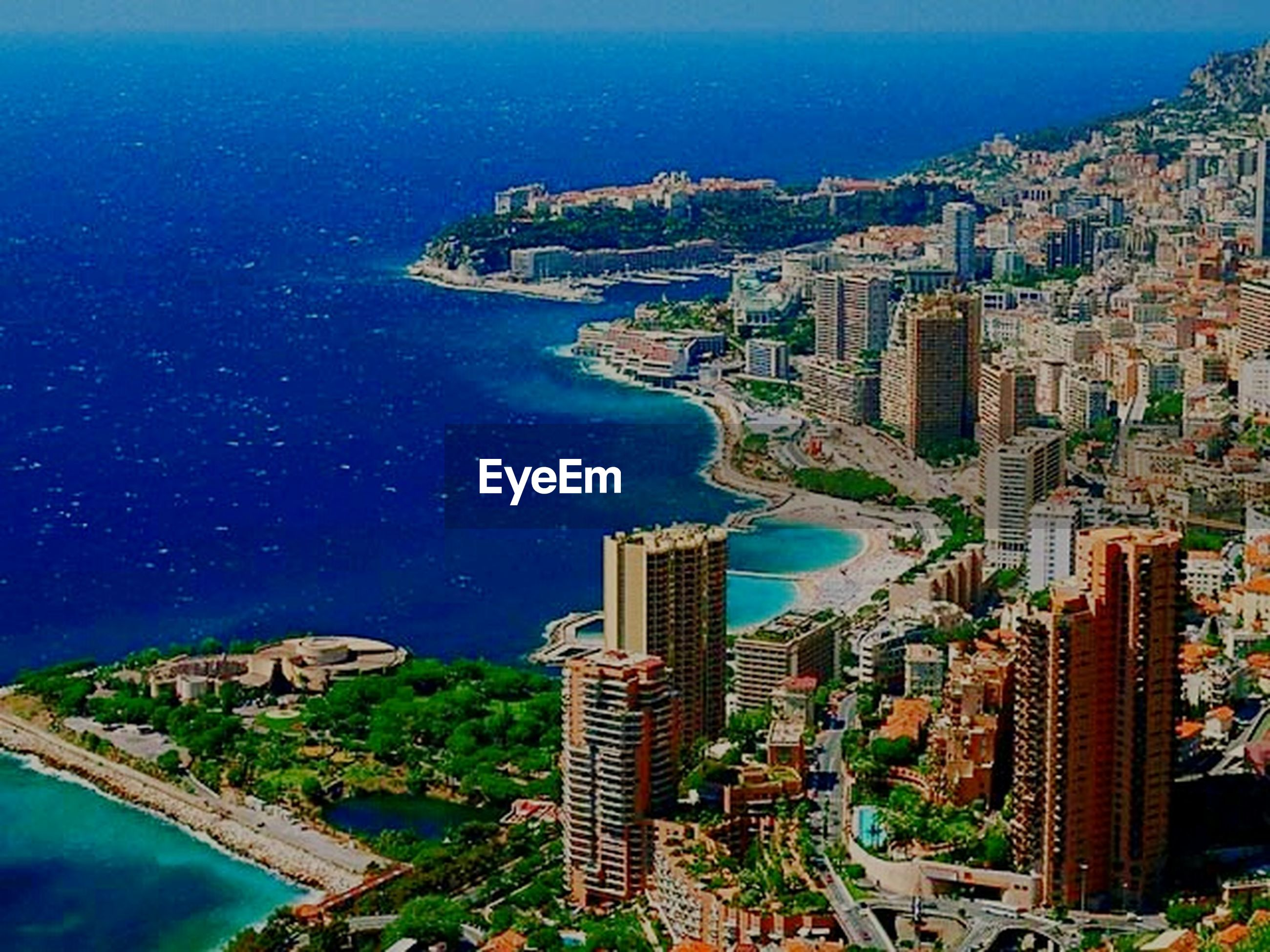 sea, water, building exterior, architecture, built structure, high angle view, city, blue, cityscape, coastline, horizon over water, residential building, aerial view, beach, residential district, residential structure, waterfront, sky, shore, nature