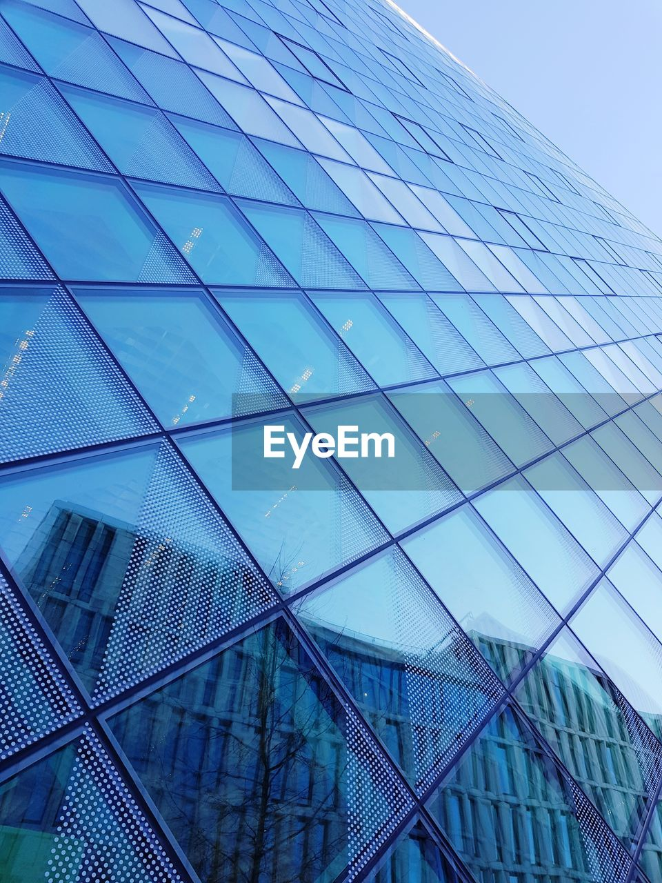 built structure, architecture, building exterior, low angle view, building, office, office building exterior, modern, glass - material, city, no people, sky, pattern, reflection, day, tall - high, skyscraper, nature, geometric shape, travel destinations, directly below