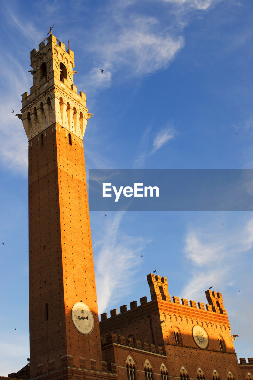 architecture, history, tower, built structure, building exterior, low angle view, sky, cloud - sky, travel destinations, ancient, spirituality, clock tower, castle, religion, clock, place of worship, fort, outdoors, no people, bell tower, day, sunlight, lookout tower, ancient civilization