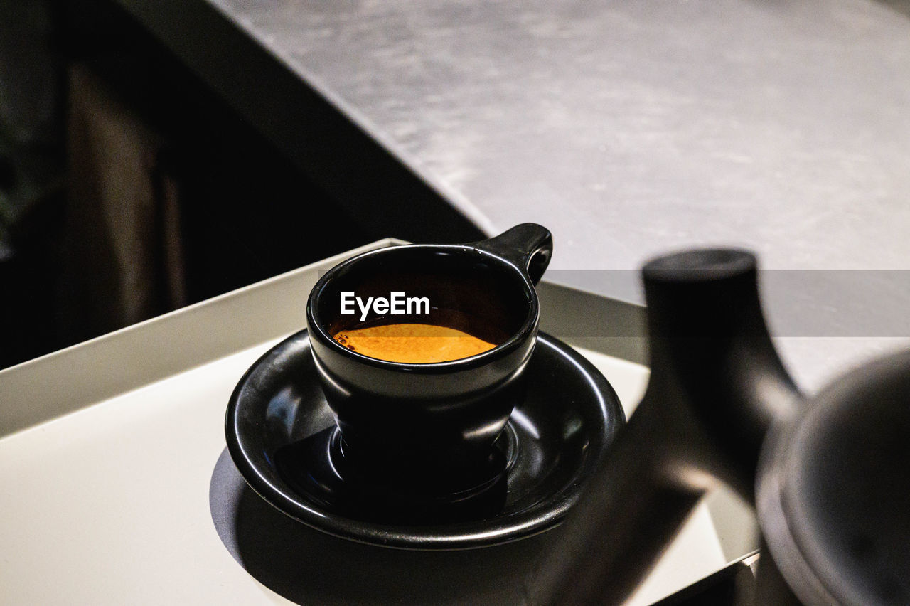 High angle view of coffee cup with espresso  on table