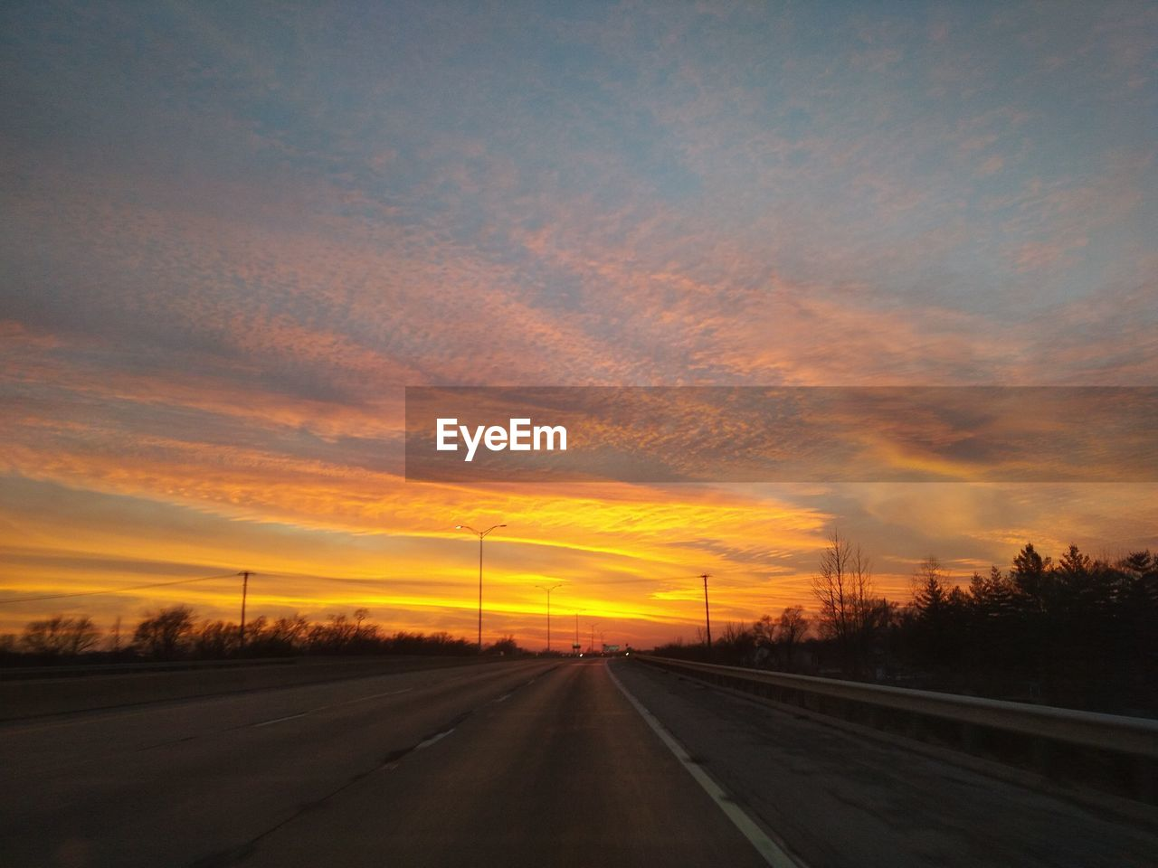sunset, orange color, road, the way forward, sky, cloud - sky, transportation, no people, sun, scenics, nature, landscape, beauty in nature, outdoors, tree, day
