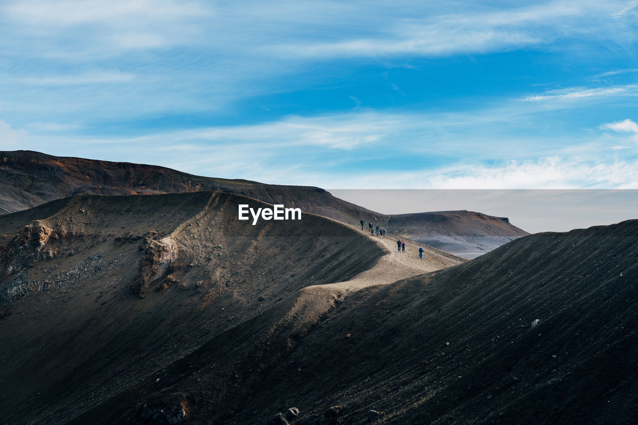 Scenic View Of Volcanic Crater Against Cloudy Sky
