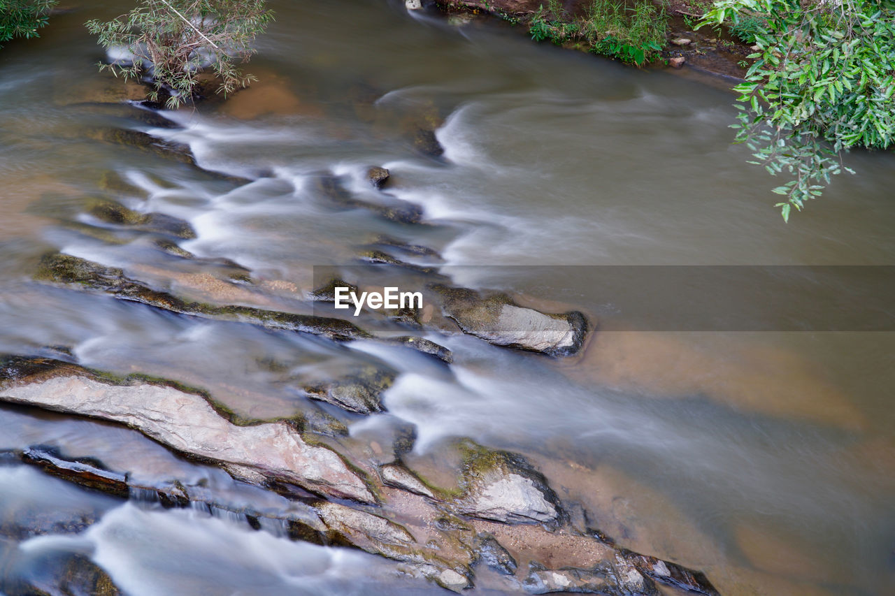 water, motion, nature, no people, day, plant, beauty in nature, long exposure, flowing water, rock, high angle view, scenics - nature, blurred motion, solid, outdoors, tree, rock - object, flowing, river, power in nature