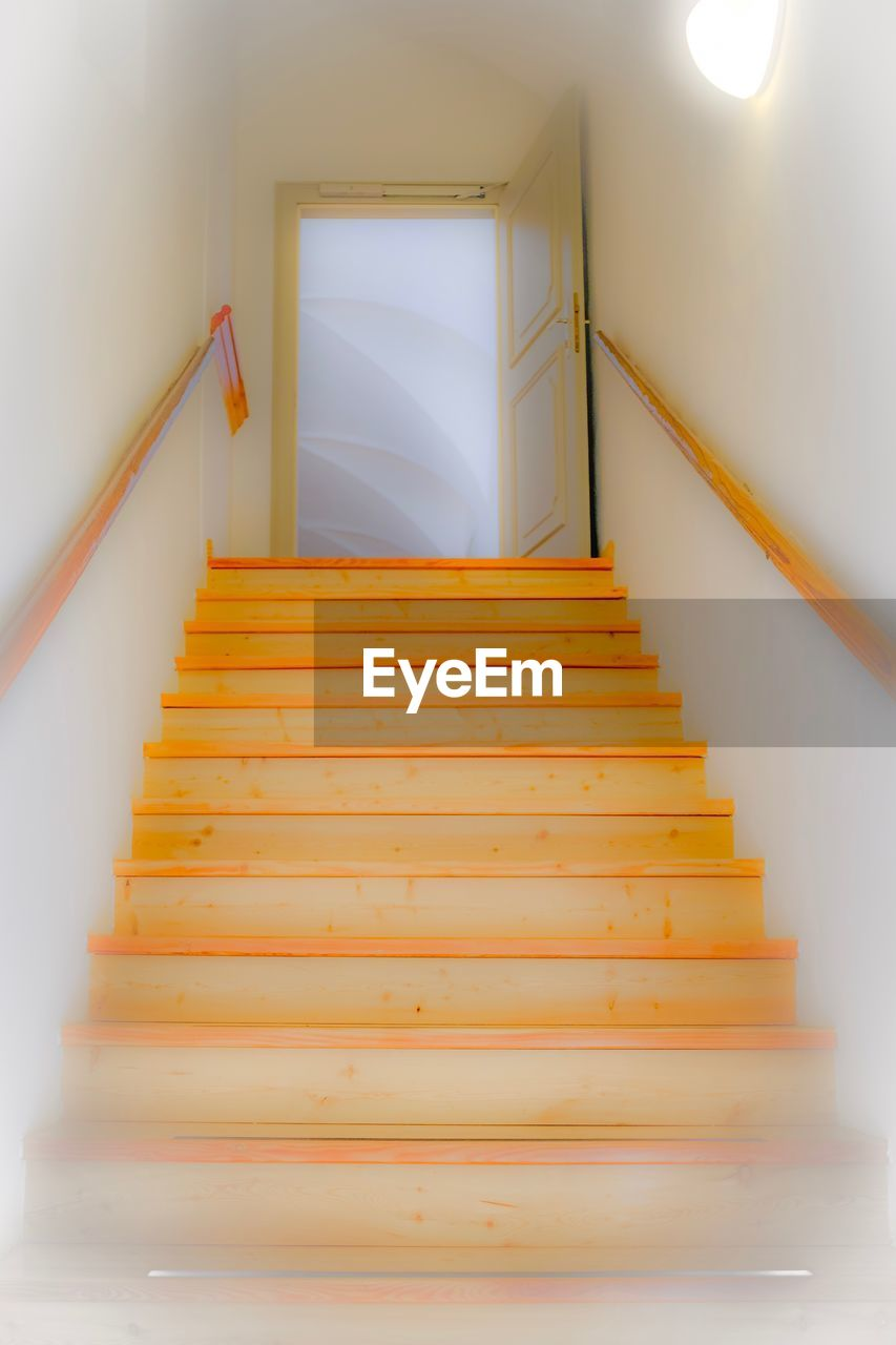 steps, steps and staircases, staircase, railing, indoors, stairs, architecture, moving up, spiral, hand rail, illuminated, built structure, low angle view, home interior, stairway, no people, the way forward, day