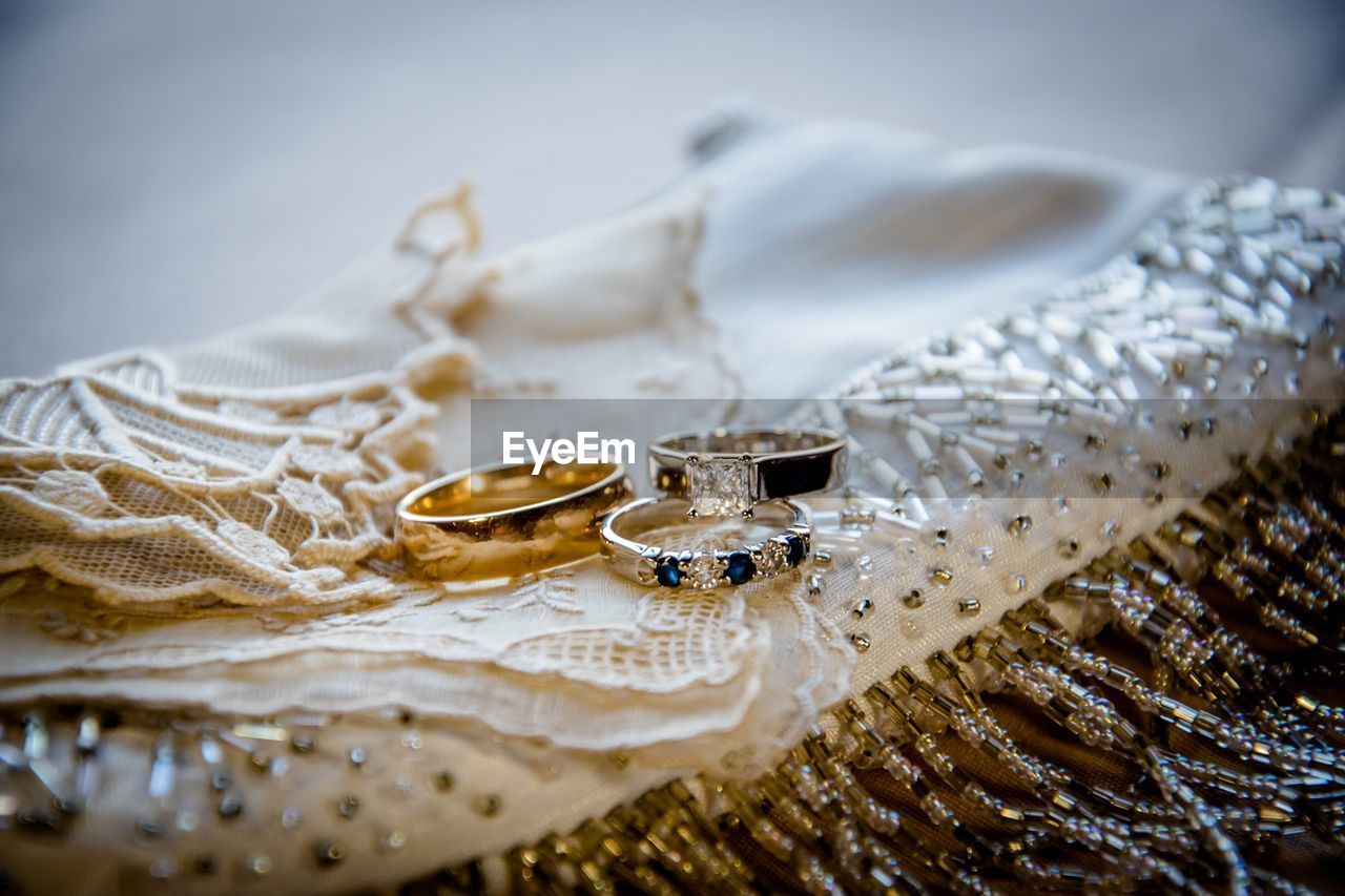 Close-Up Of Wedding Rings On Cloth