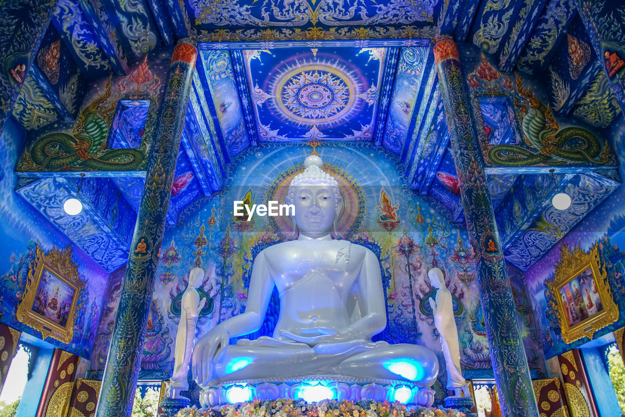 human representation, religion, spirituality, place of worship, representation, belief, architecture, art and craft, male likeness, built structure, indoors, low angle view, building, creativity, illuminated, sculpture, no people, statue, ceiling, mural, idol, ornate