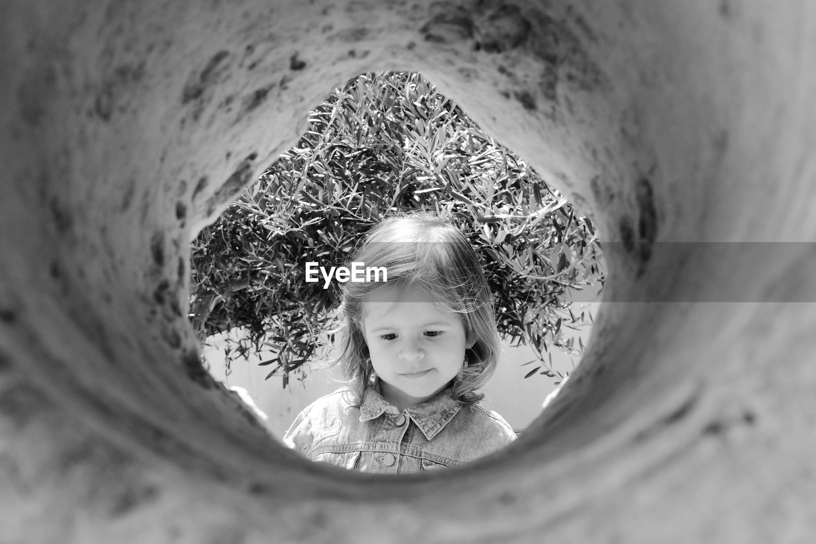Cute girl seen through hole