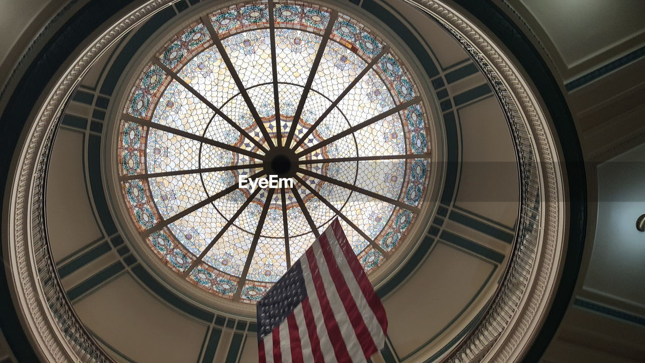 Low Angle View Of American Flag Below Cupola In Courtroom