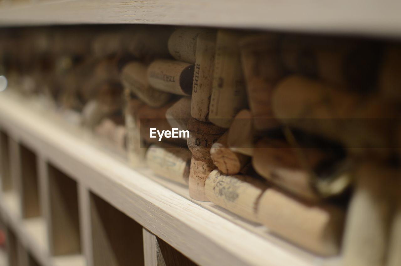 Close-up of wine corks in shelf