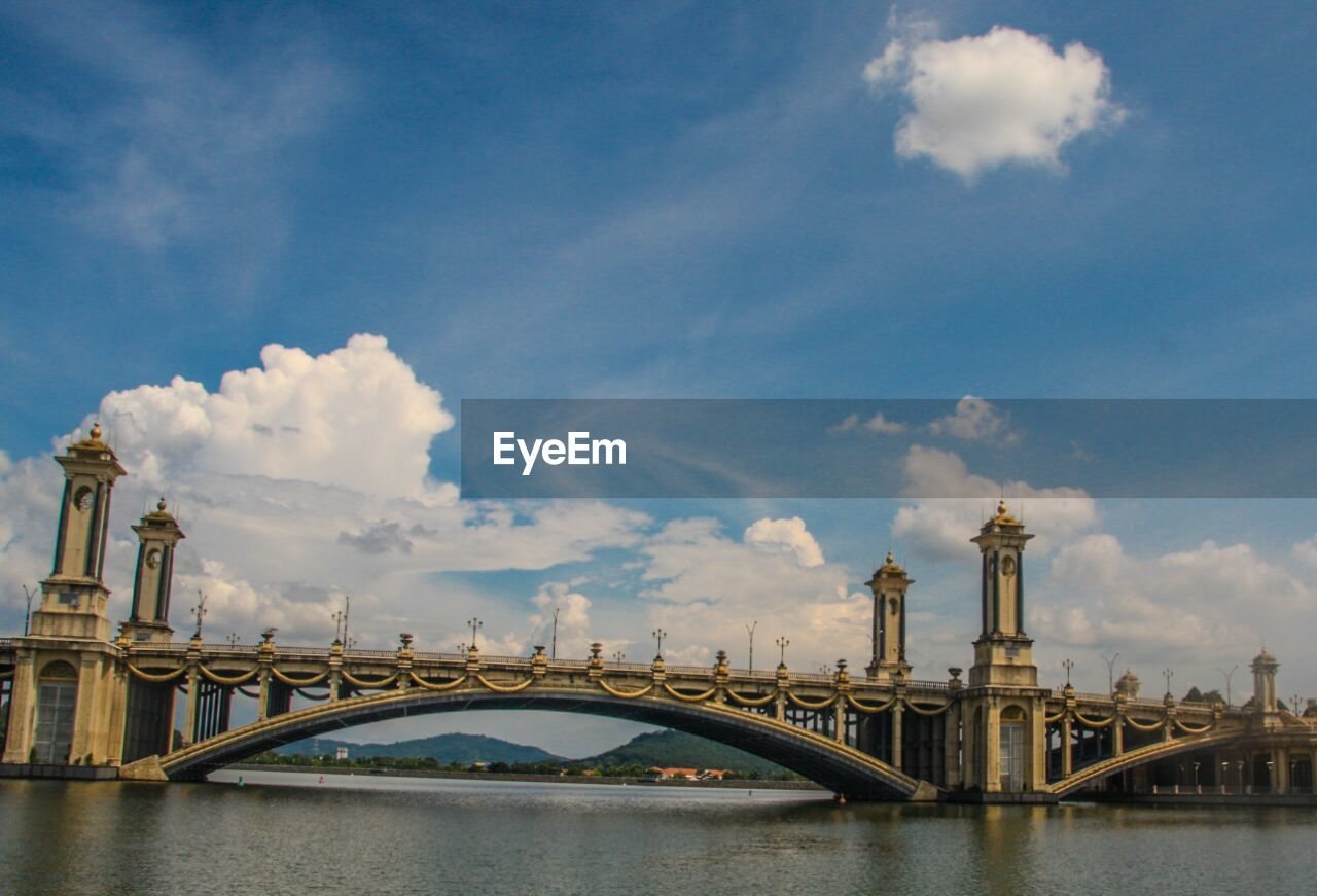 cloud - sky, sky, architecture, built structure, connection, building exterior, water, transportation, waterfront, bridge - man made structure, day, river, no people, outdoors, city, travel destinations, nautical vessel, nature