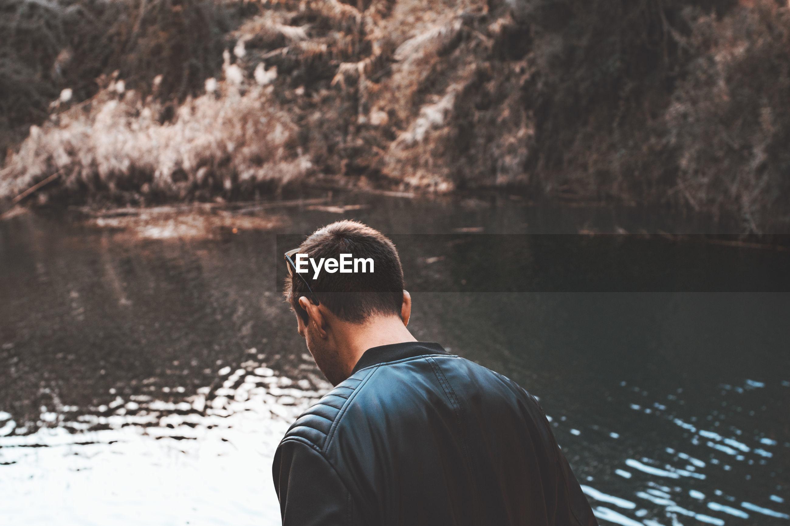 Man against lake