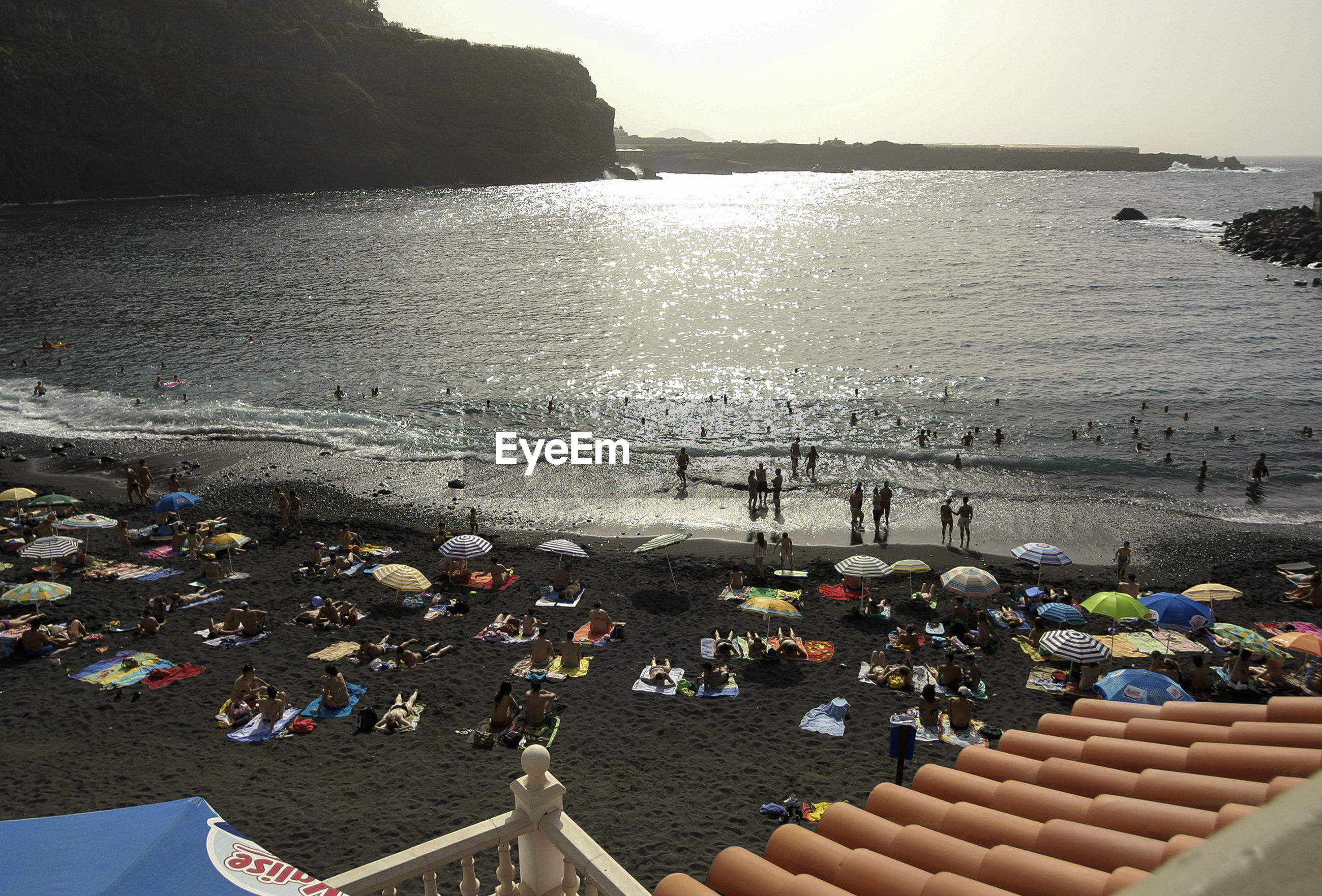 High angle view of people at beach against clear sky