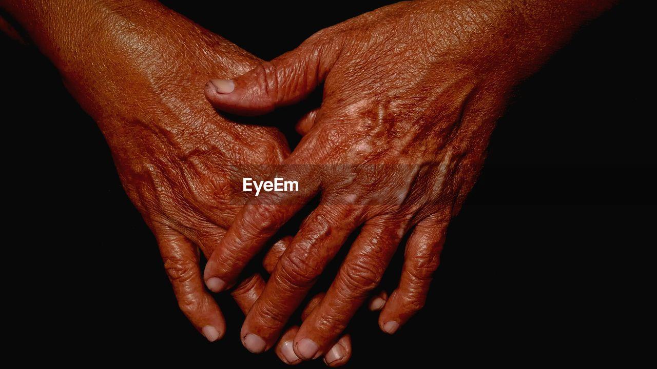 Close-Up Of Old Wrinkled Hands